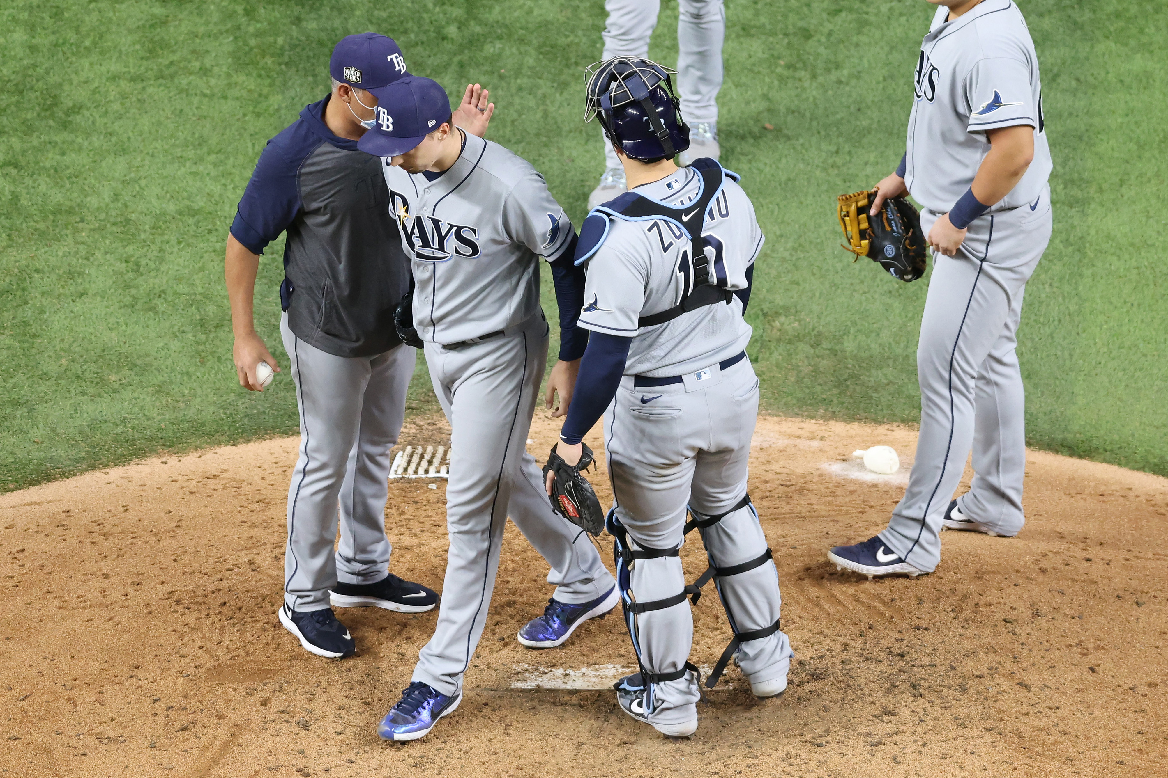 Blake Snell #4 of the Tampa Bay Rays is taken out of the game by manager Kevin Cash during the sixth inning against the Los Angeles Dodgers in Game Six of the 2020 MLB World Series at Globe Life Field on October 27, 2020 in Arlington, Texas.