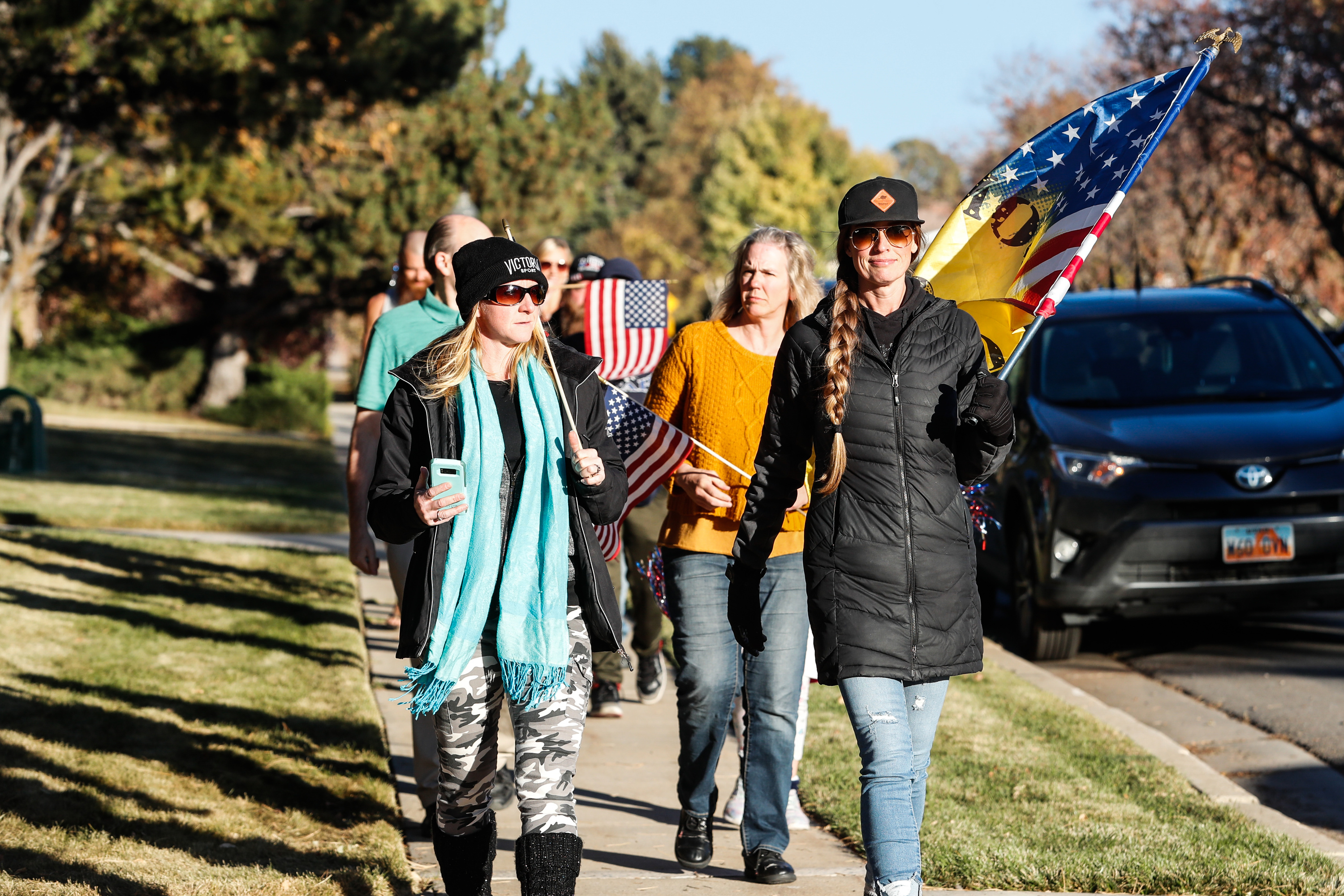 Protesters march towardstate epidemiologist Dr. Angela Dunn's house during a peaceful protest in Salt Lake City on Thursday, Oct. 29, 2020.