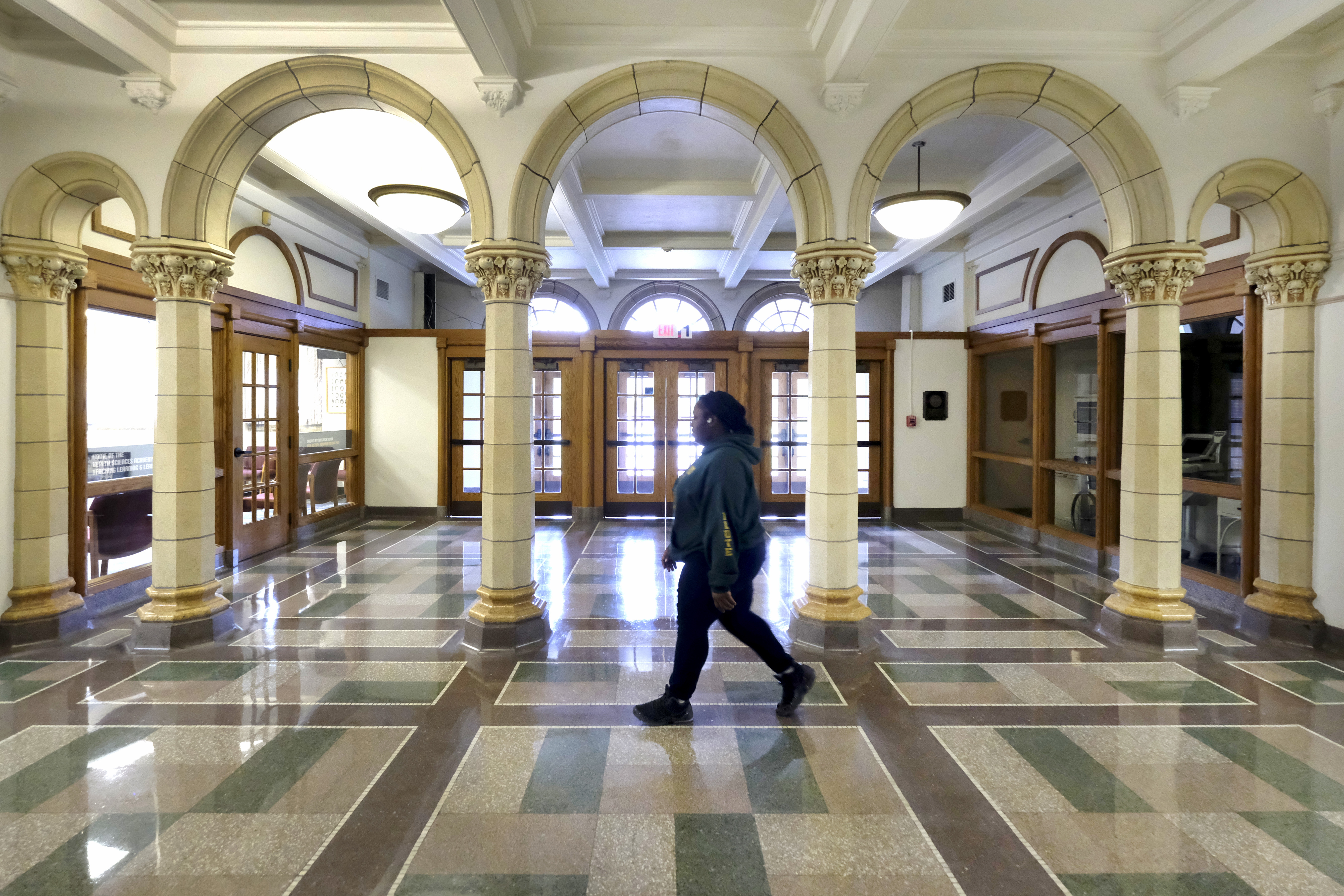 A person walks across a hall in Crispus Attucks High School, Indianapolis.