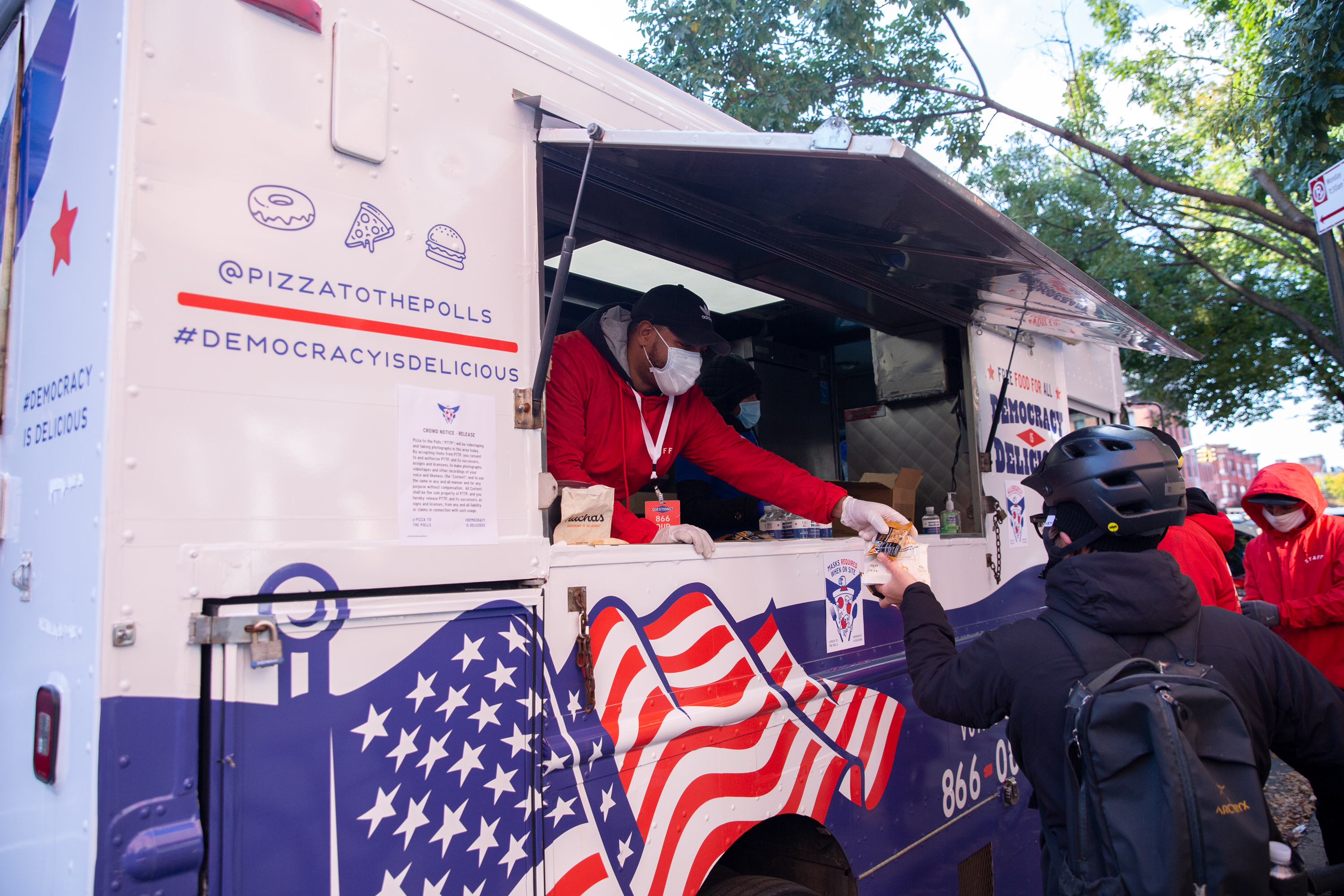 Food truck workers give away free meals during early voting outside the Park Slope Armory, Oct. 31, 2020.