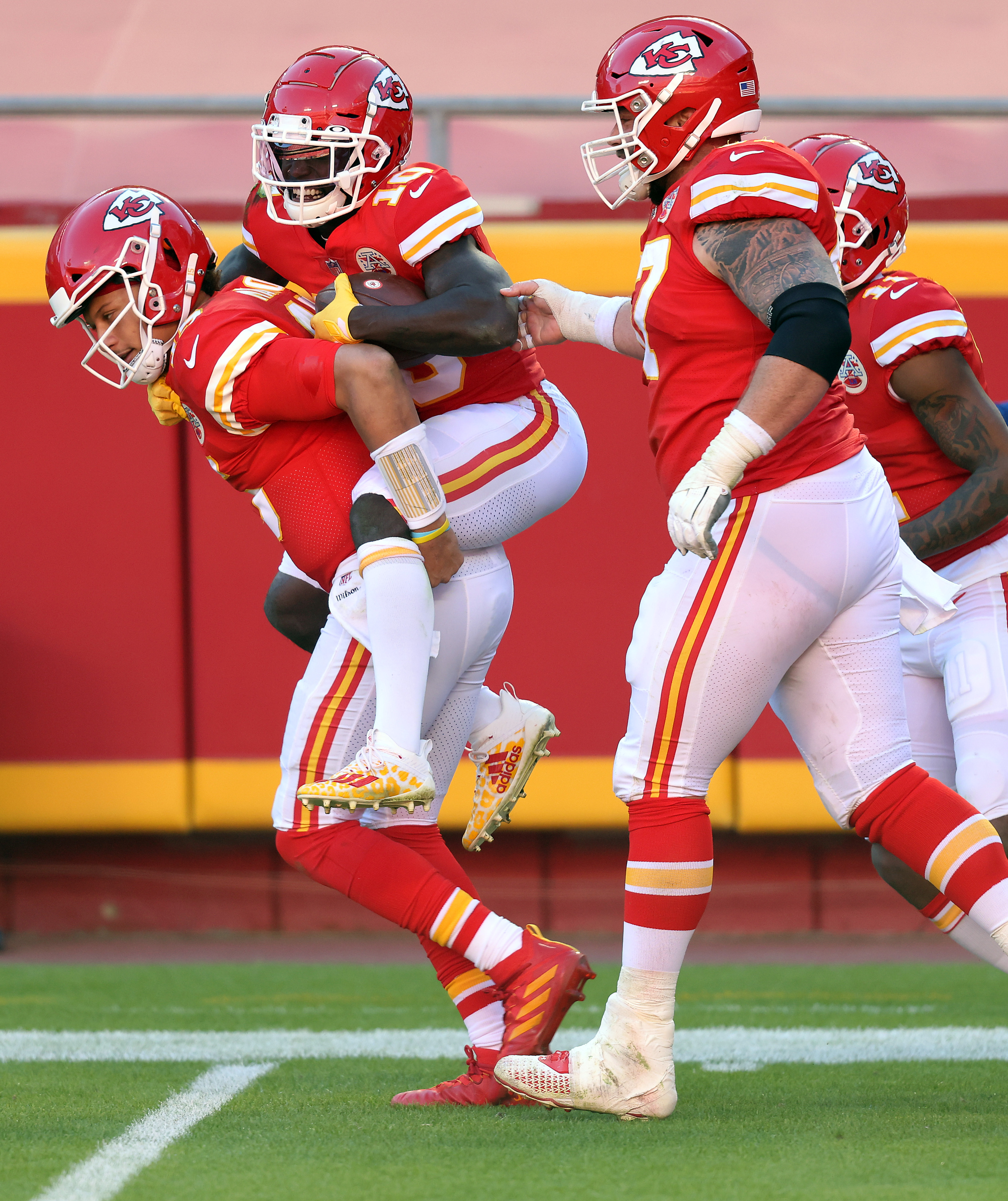 Tyreek Hill #10 of the Kansas City Chiefs celebrates with Patrick Mahomes #15 after a 41-yard touchdown against the New York Jets during their NFL game at Arrowhead Stadium on November 01, 2020 in Kansas City, Missouri.