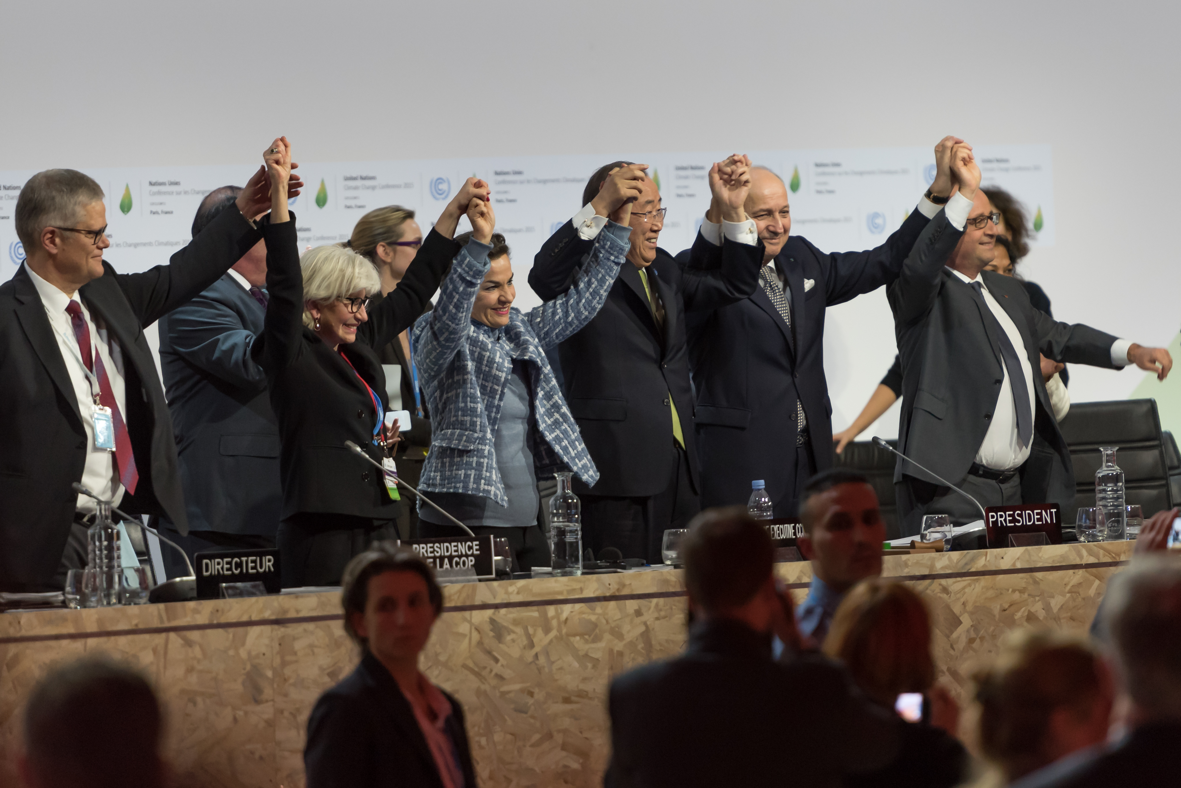 Negotiators celebrate the conclusion of the COP21 Climate Conference in Paris, France, in 2015.