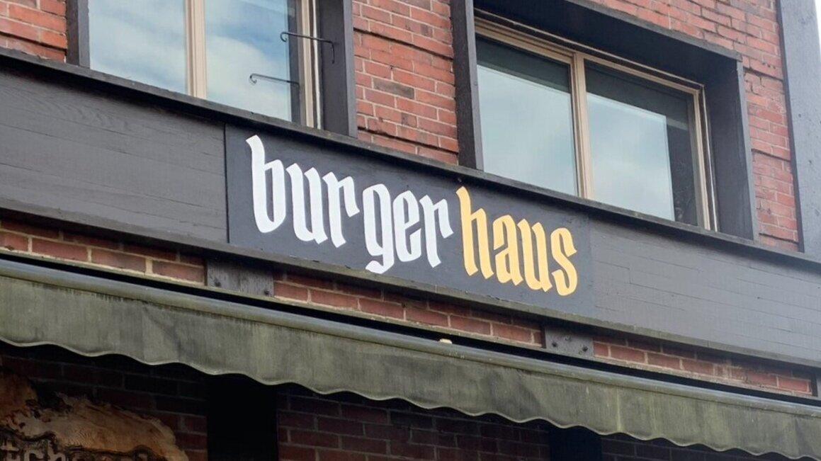 "A sign that says ""Burgerhaus"" outside Bainbridge Island restaurant Hitchcock"