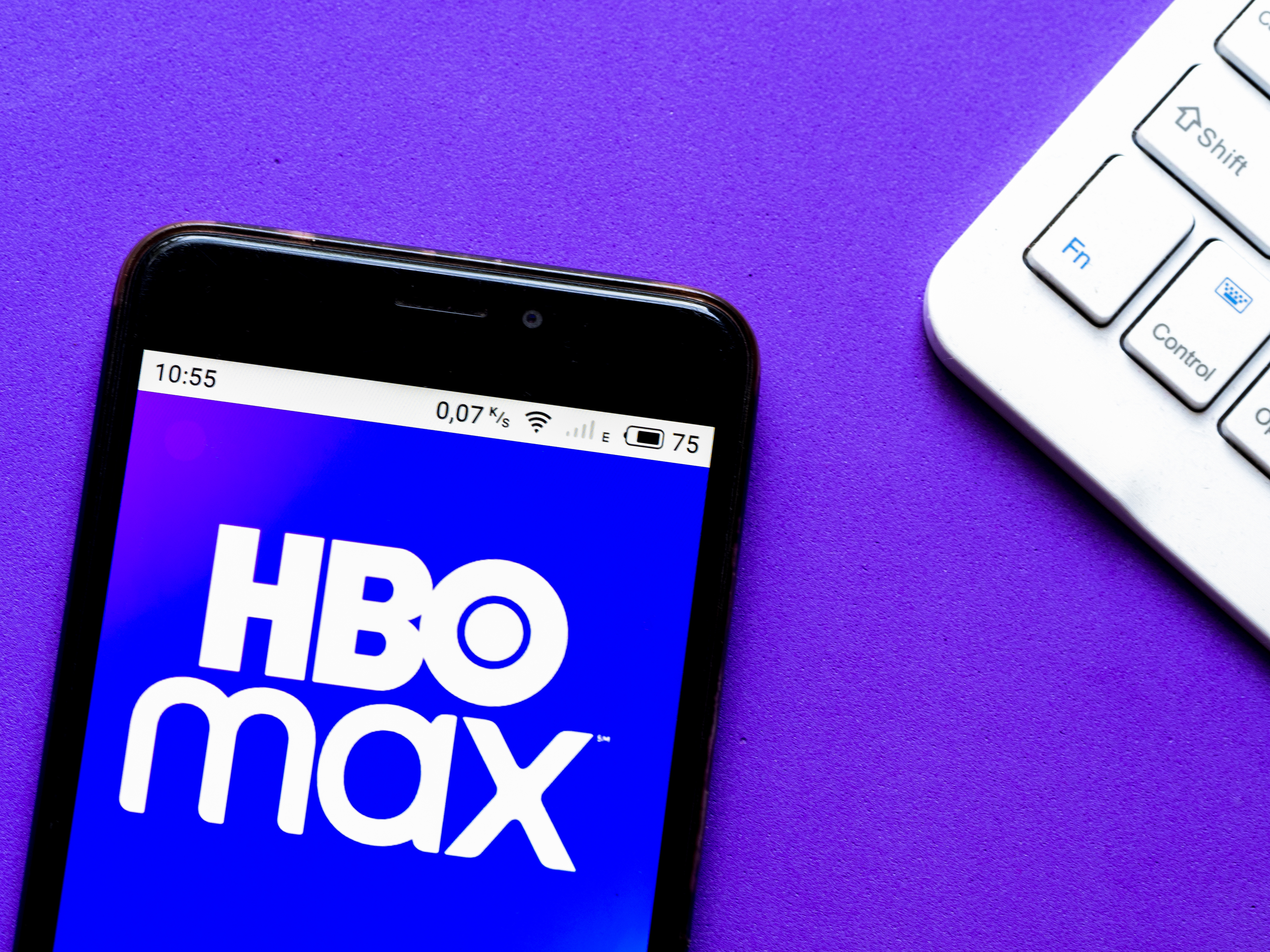 In this photo illustration an HBO Max logo seen displayed on...