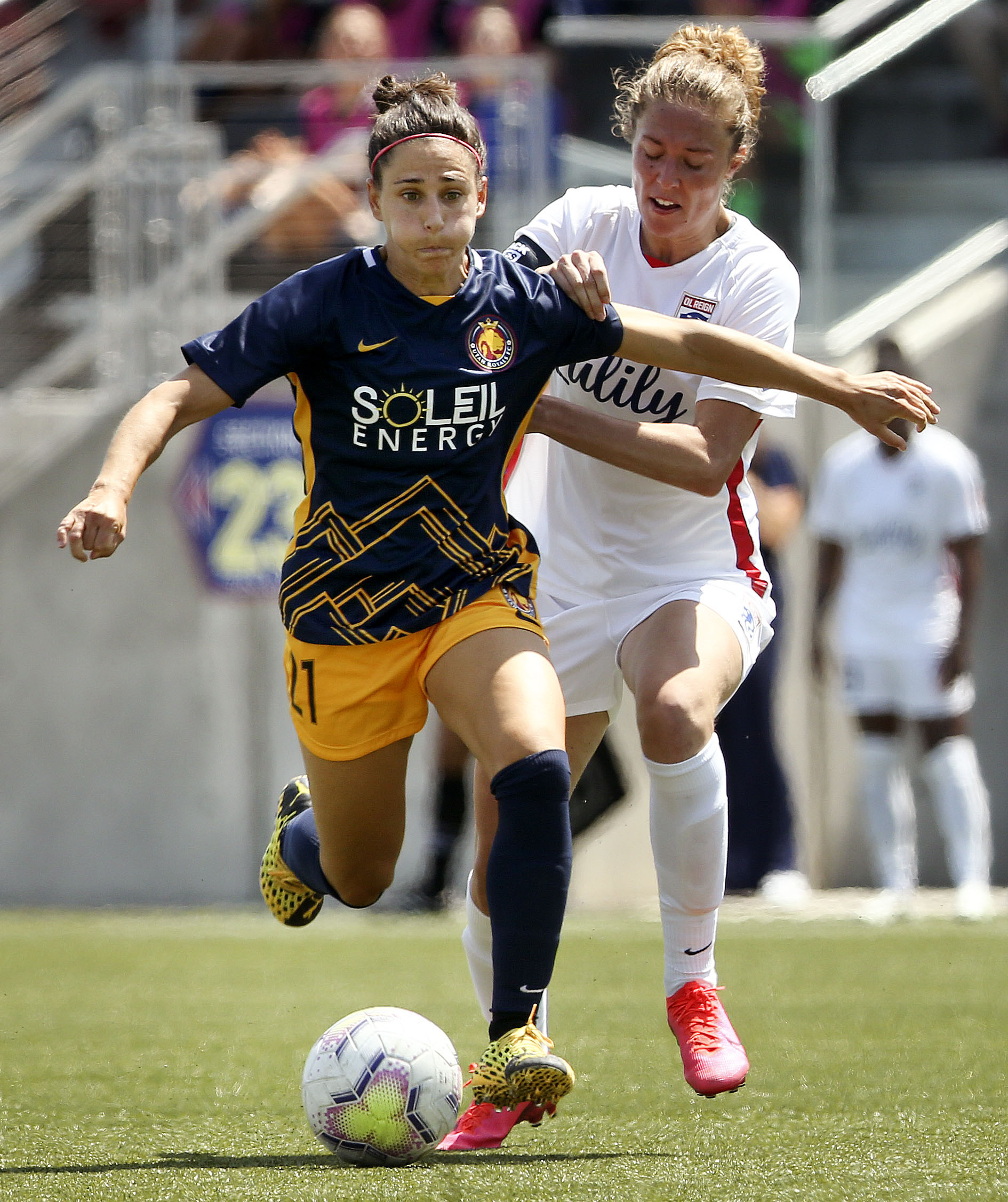 Utah Royals player Veronica Boquete (21) drives to the goal against OL Reign Celia defender Jimenez Delgado in a 2020 NWSL Challenge Cup game at Zions Bank Stadium in Herriman on Wednesday, July 8, 2020.