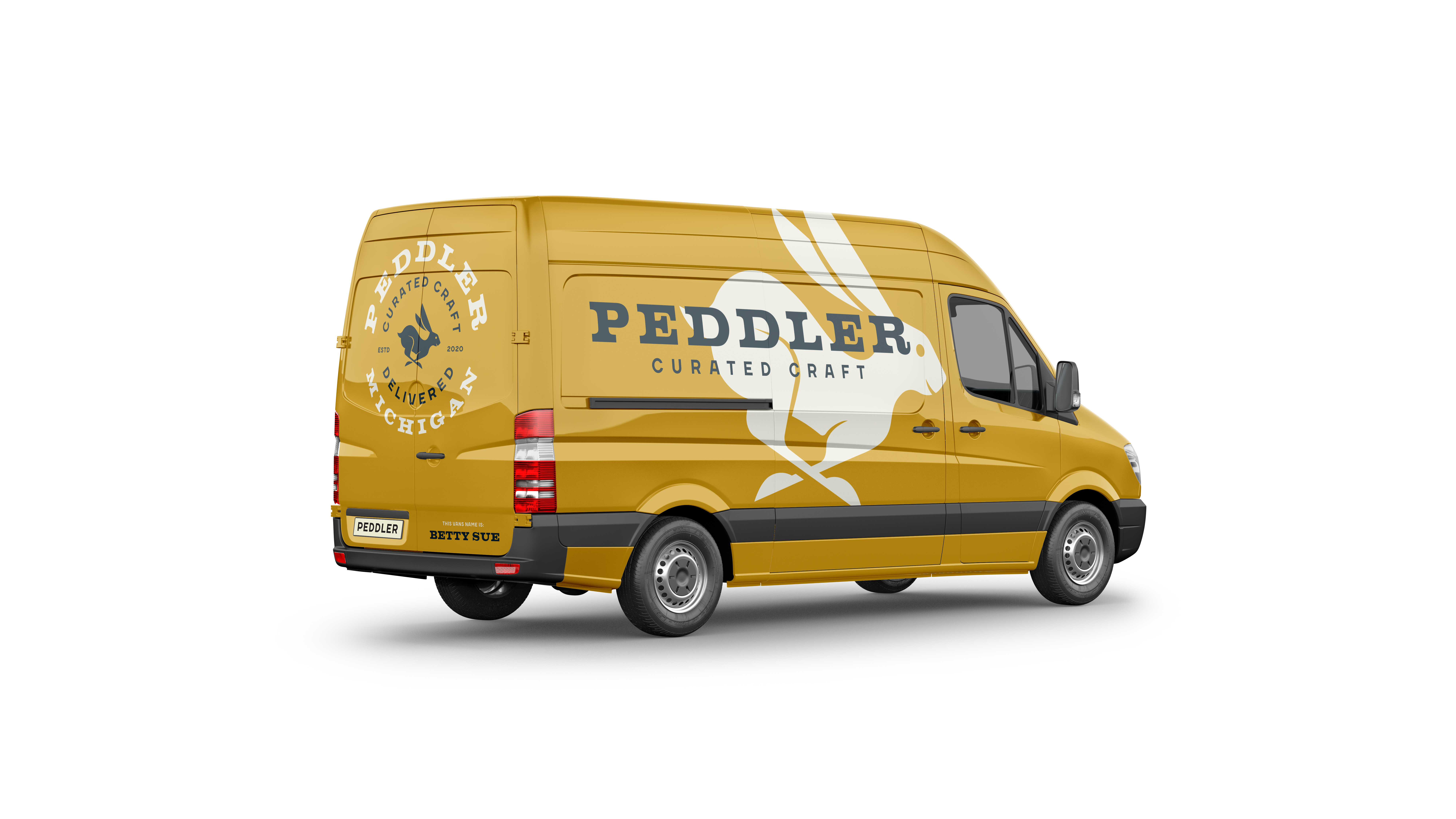 A yellow delivery van with the peddler logo, a jack rabbit, on the side.