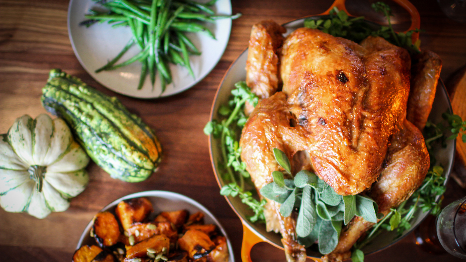 A roasted turkey with autumnal squash.