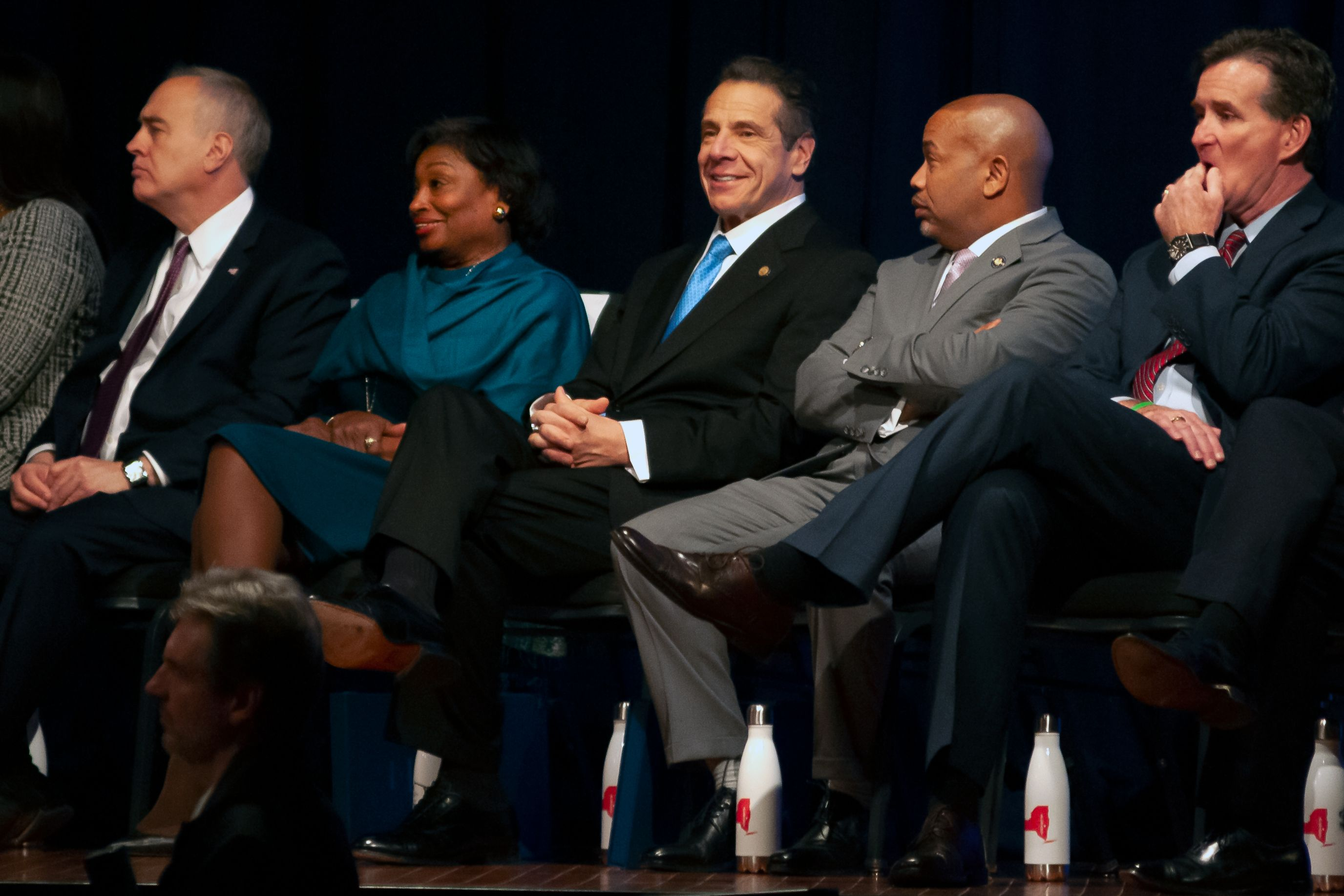 Governor Andrew Cuomo sits with Senate Majority Leader Andrea-Stewart-Cousins and Assembly Speaker Carl Heastie before delivering his State of the State address in Albany.