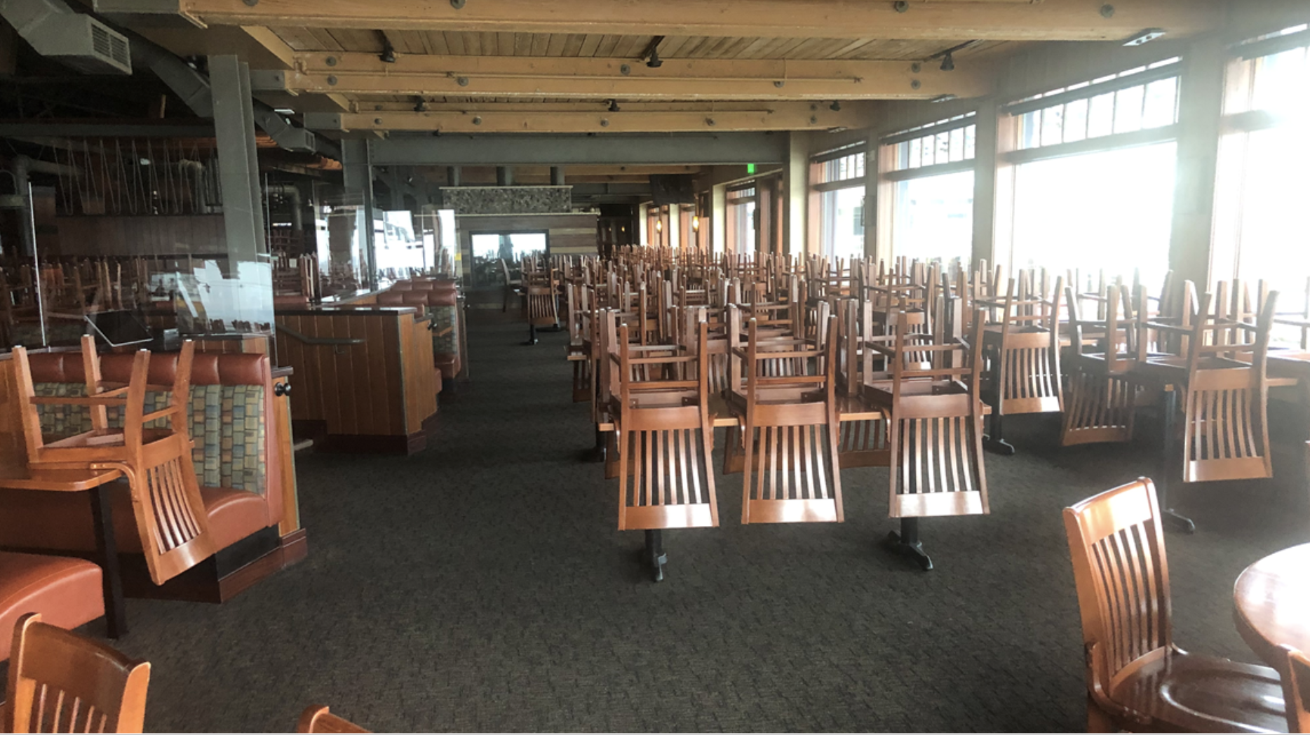 The empty dining room at Ivar's Acres of Clams, with chairs stacked upside down on tables