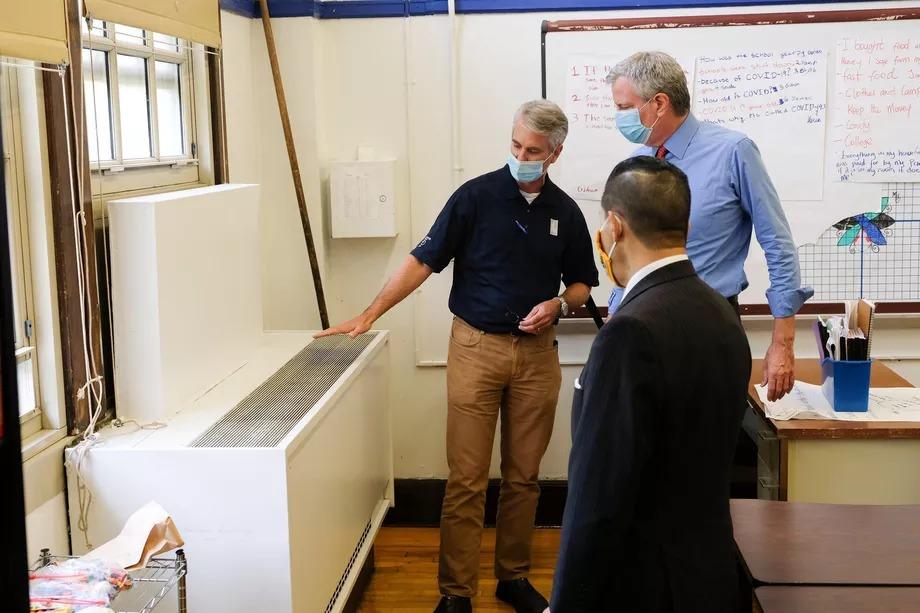 Mayor Bill de Blasio and Schools Chancellor Richard Carranza observed a school's ventilation system on Aug. 26, 2020. Teachers remain skeptical of ventilation fixes.