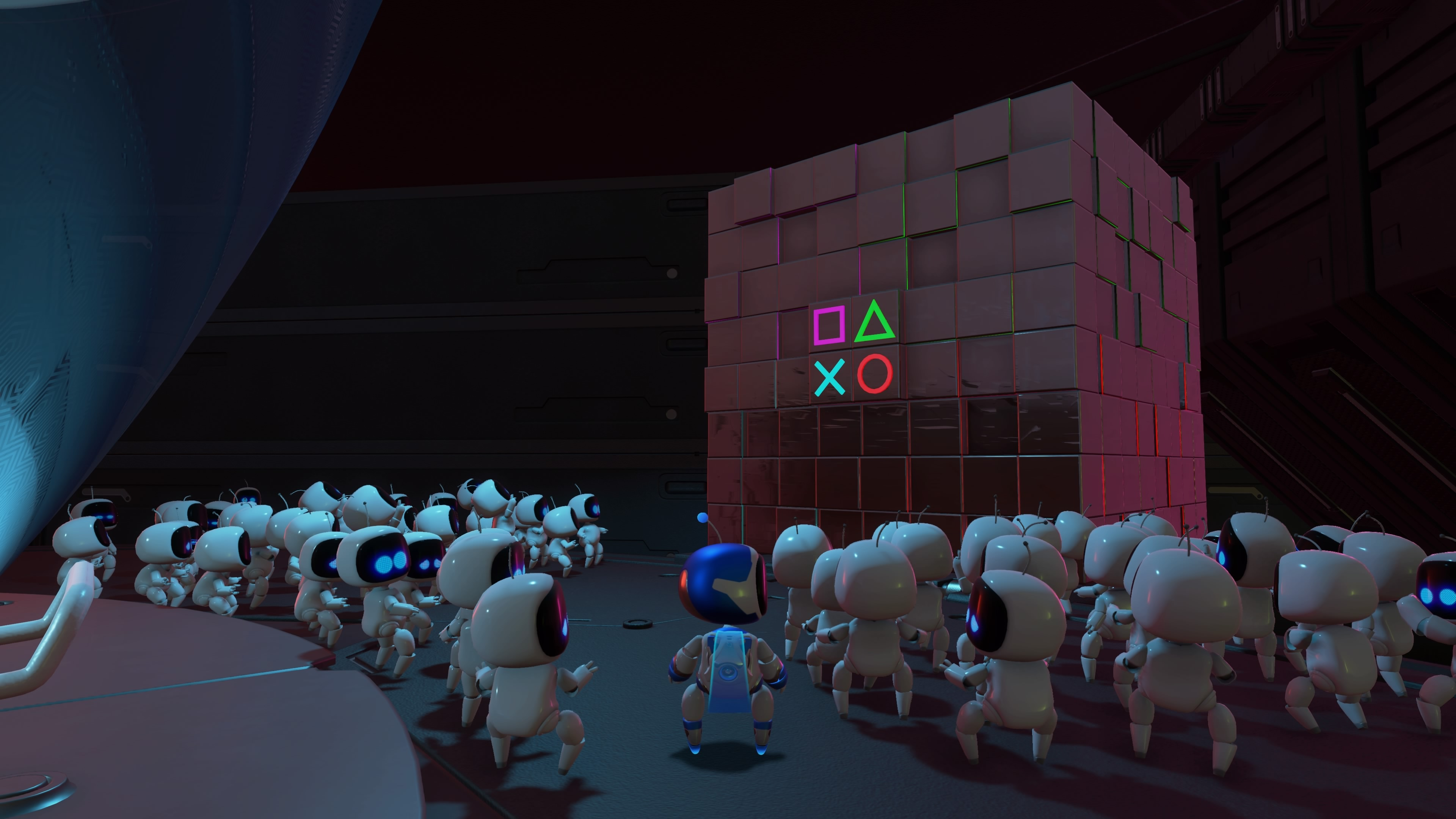 Astro Bots crowd around a PlayStation monument in Astro's Playroom