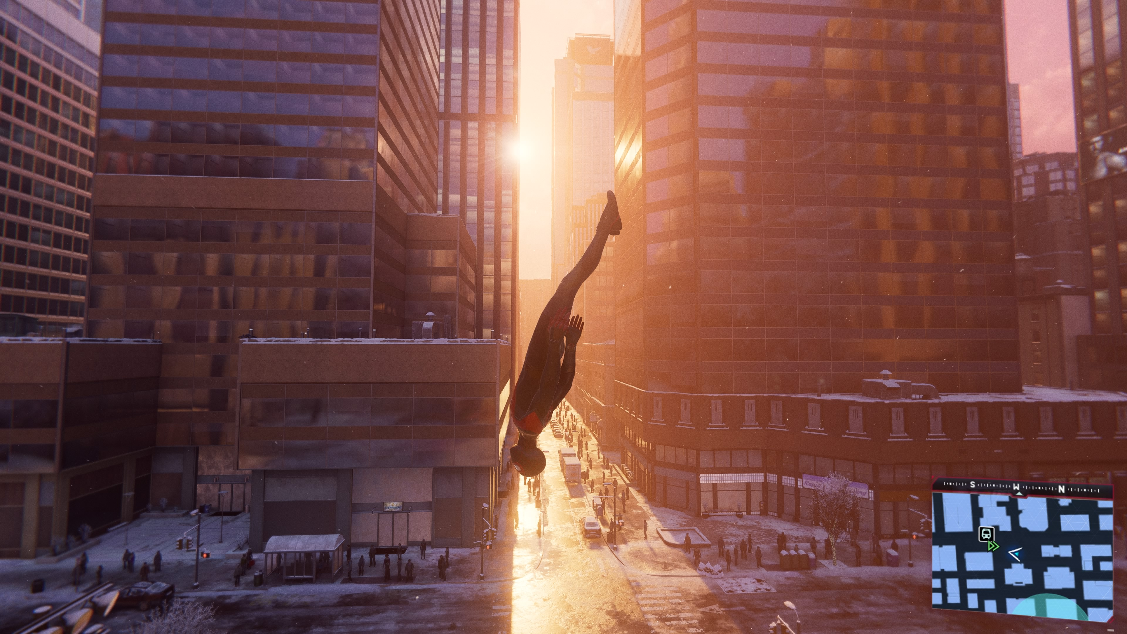 Spider-Man diving toward the ground with the sun behind him in Spider-Man: Miles Morales on PS5