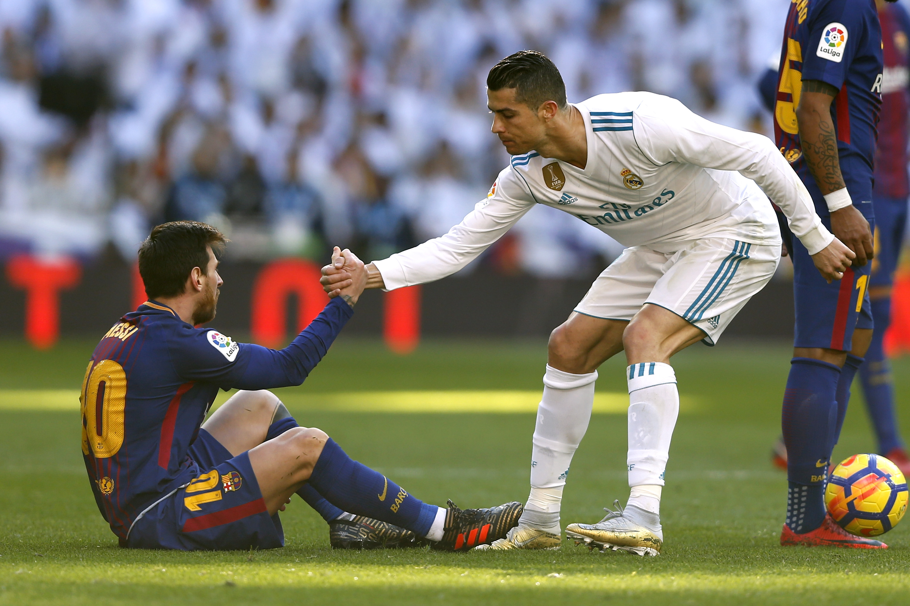 Cristiano Ronaldo helps Lionel Messi - Real Madrid v Barcelona - La Liga