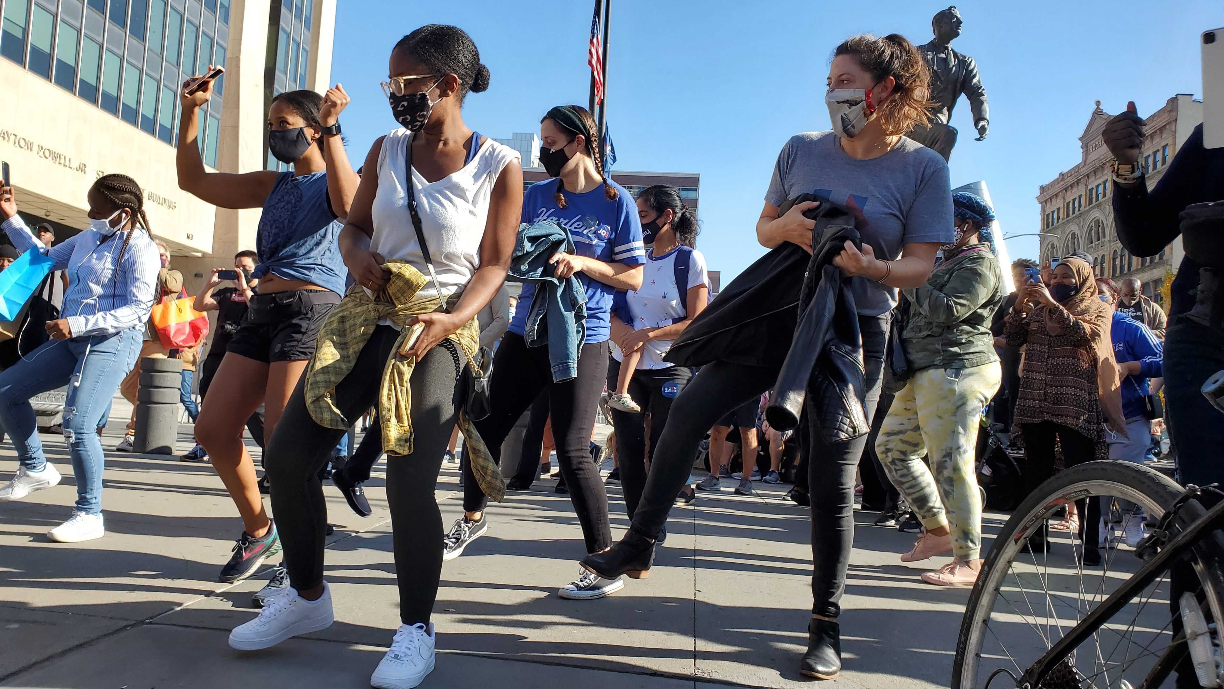"""In Harlem, New Yorkers danced and banged pots while singing """"Na Na Hey Hey Kiss Him Goodbye."""""""