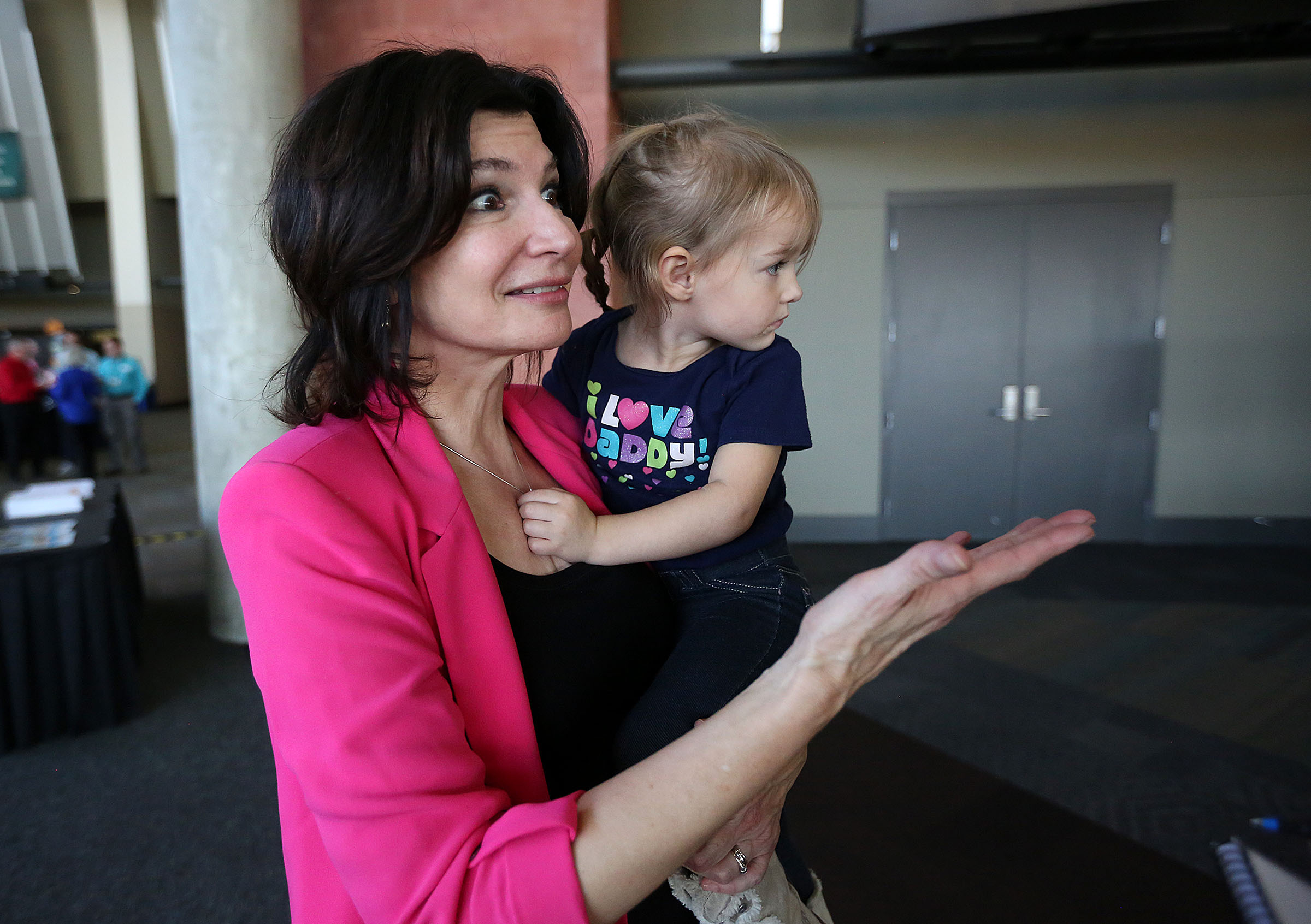 Lily Eskelsen Garcia, president of the National Education Association, holds her granddaughter, Lily Jo Eskelsen, at the annual Utah Education Association convention in Sandy in 2017. Eskelsen Garcia is considered a contender for education secretary in the administration of President-elect Joe Biden, according to Politico.
