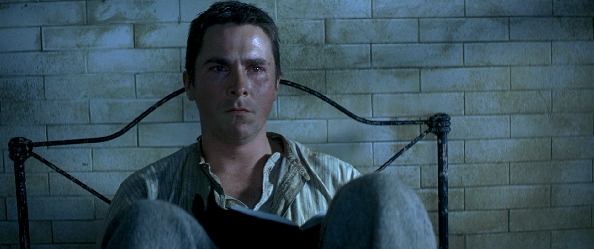 The Prestige: Christian Bale sits in bed feeling weepy