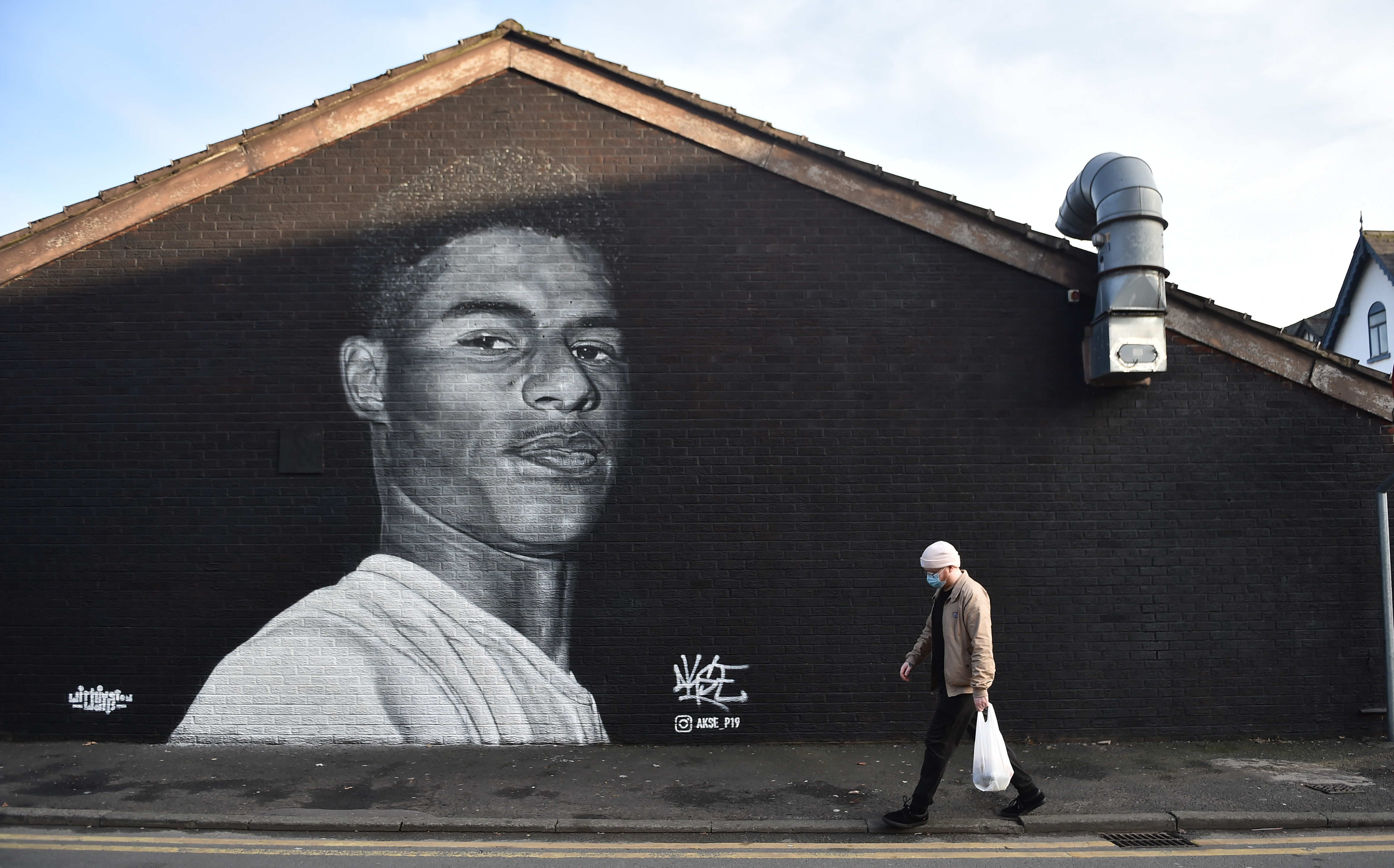 A mural of footballer Marcus Rashford in Manchester, painted by street artist Akse