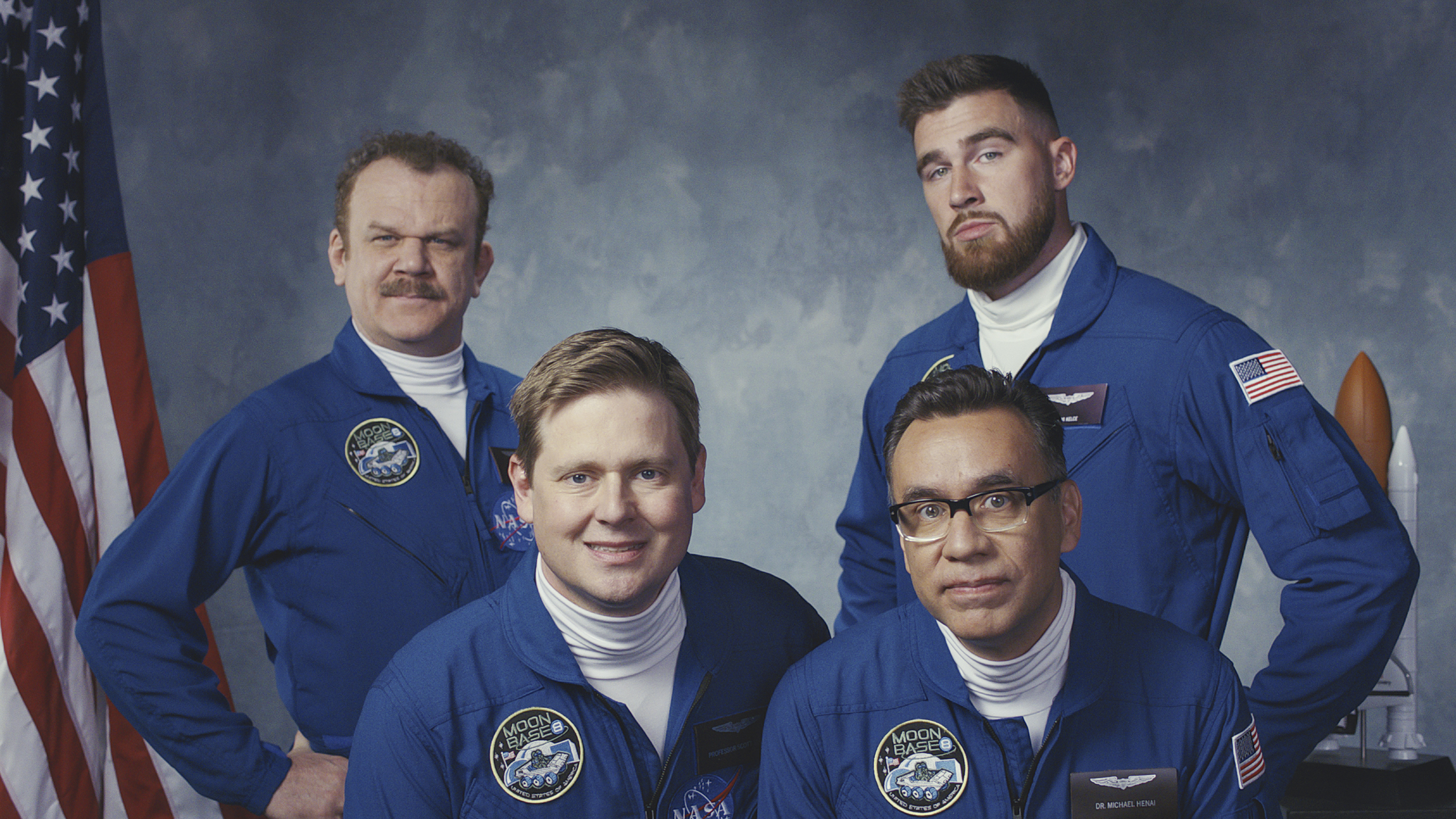 John C. Reilly, Tim Heidecker, Fred Armisen, and Travis Kelce in a posed photo for Moonbase 8