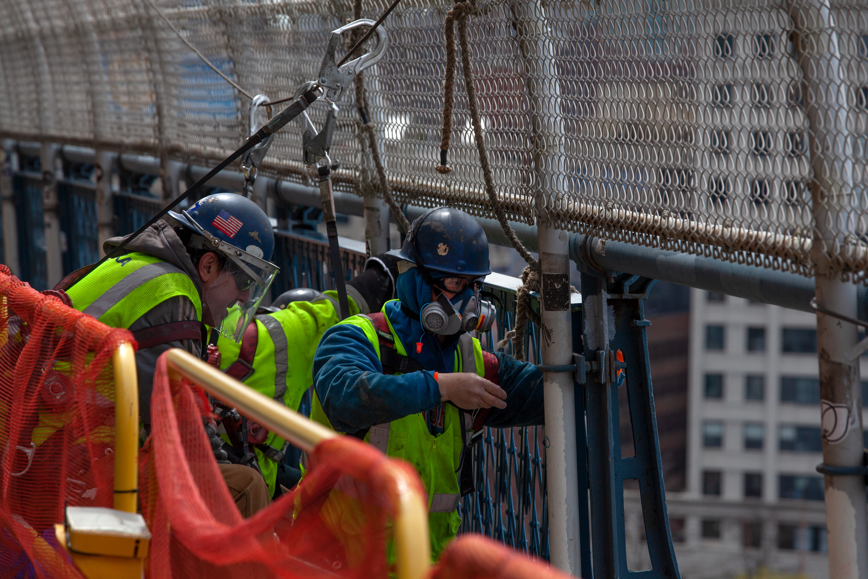 Construction workers make repairs on the Manhattan Bridge during the coronavirus outbreak, April, 14, 2020.
