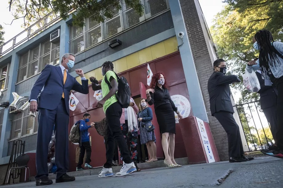 Mayor Bill de Blasio greeted students returning to One World Middle School at Edenwald in The Bronx.
