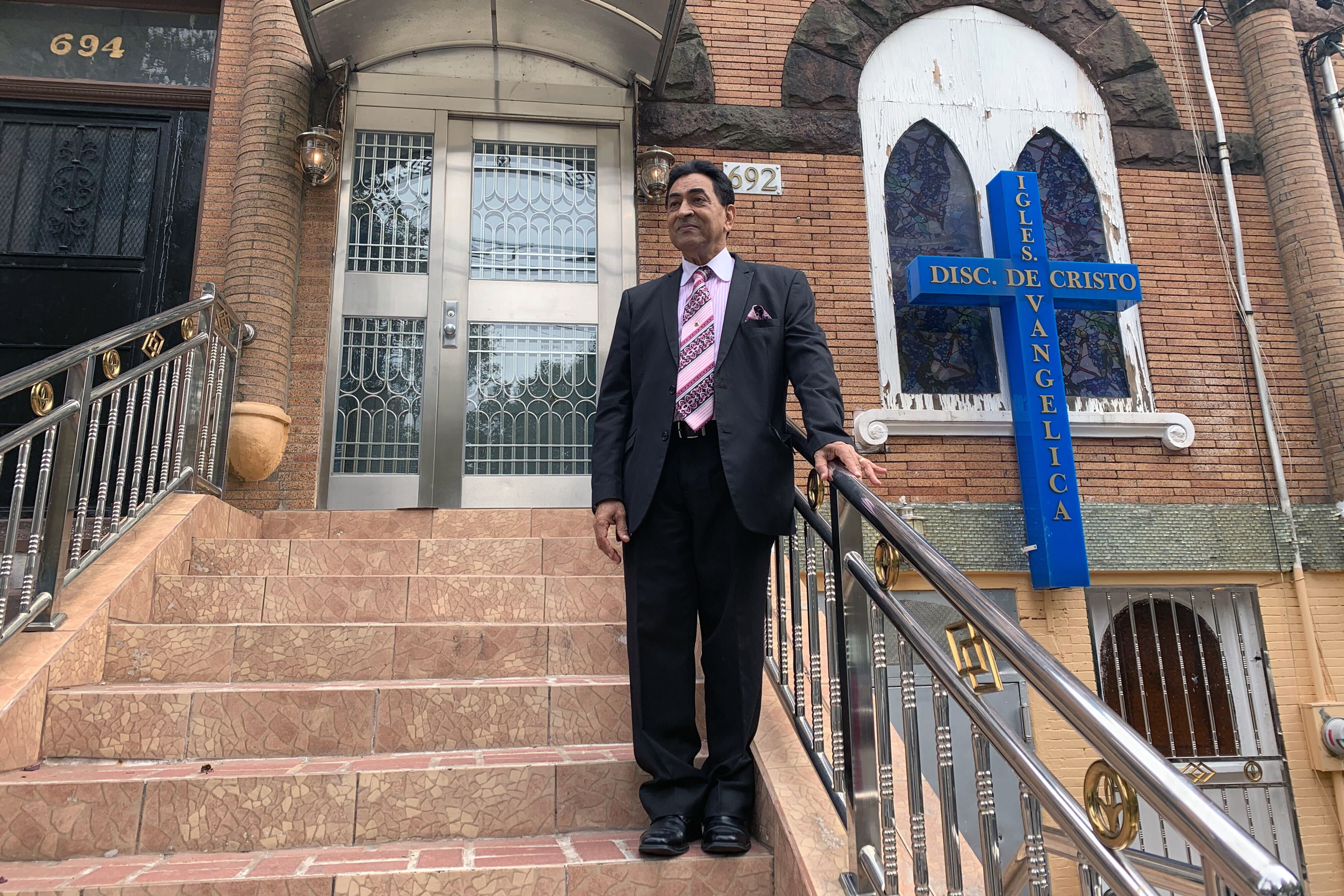 Pastor Felix Gross stands into front of the Bronx church he's led since 1979, Oct. 25, 2020.
