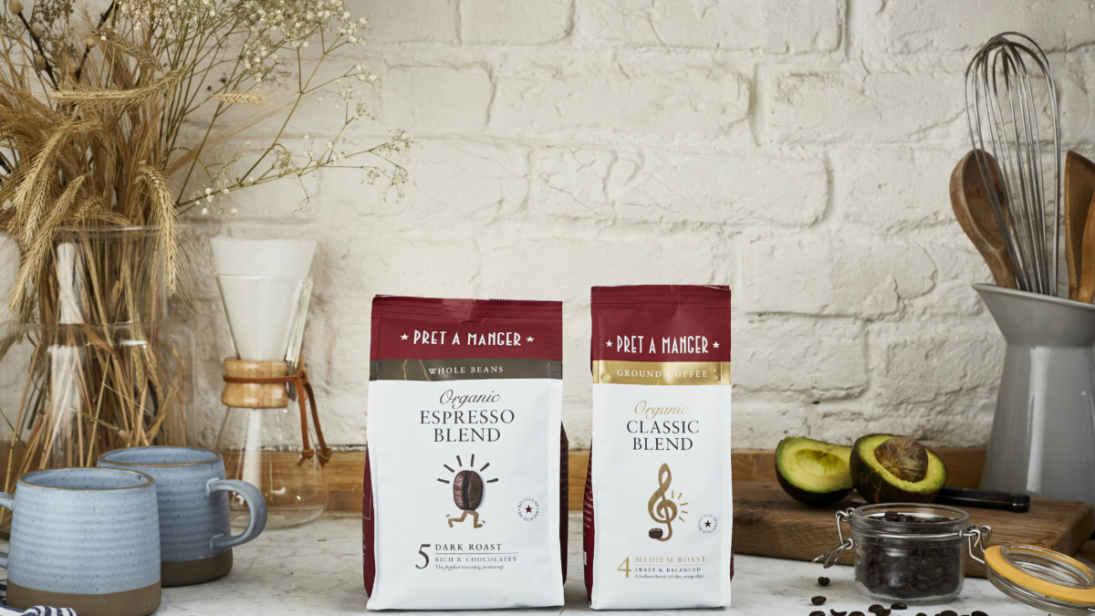 Two bags of Pret-a-Manger branded coffee, with hand-thrown ceramics and an avocado in the background