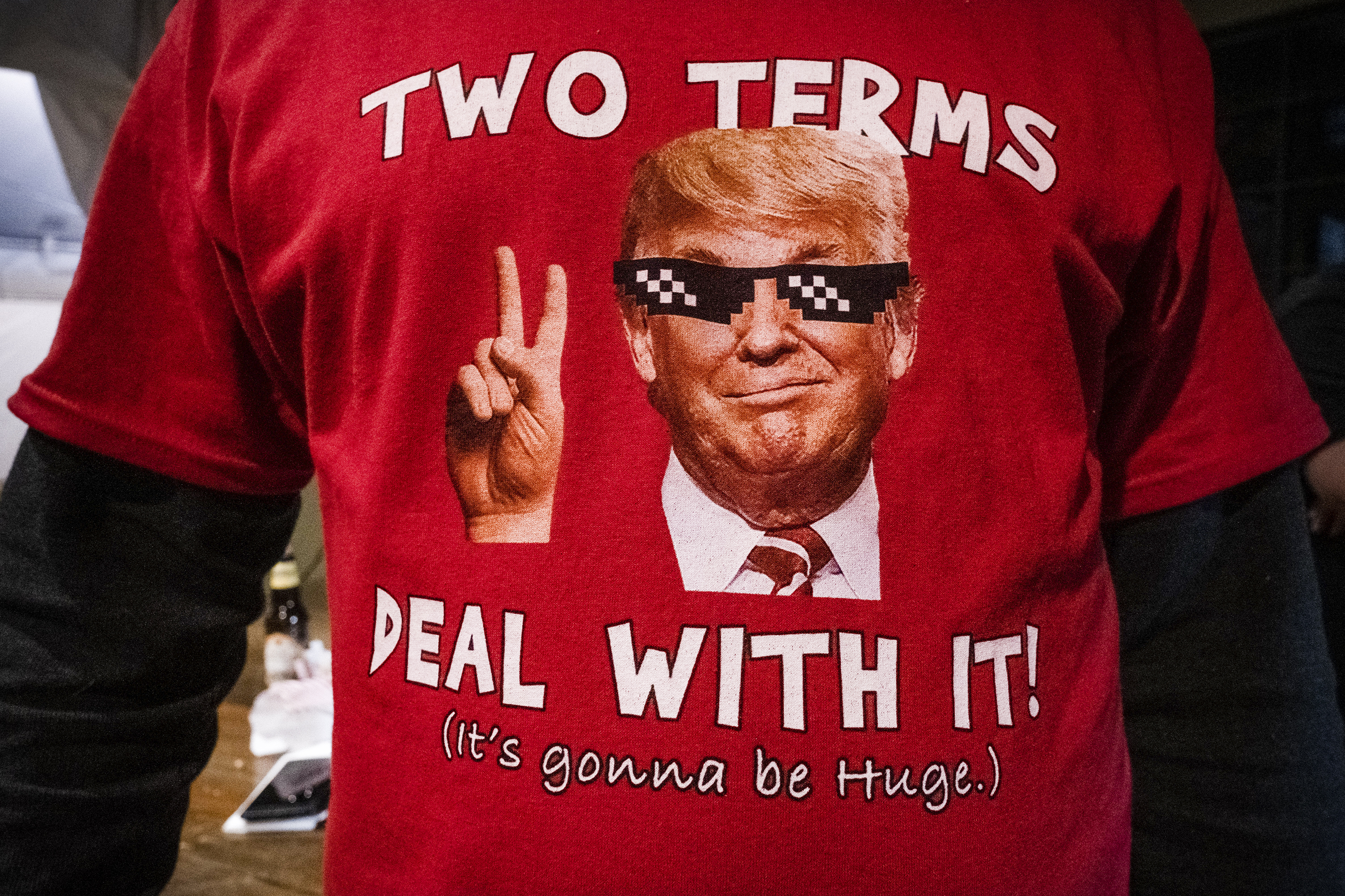 """A person wearing a Trump shirt that reads """"Two terms. Deal with it."""""""