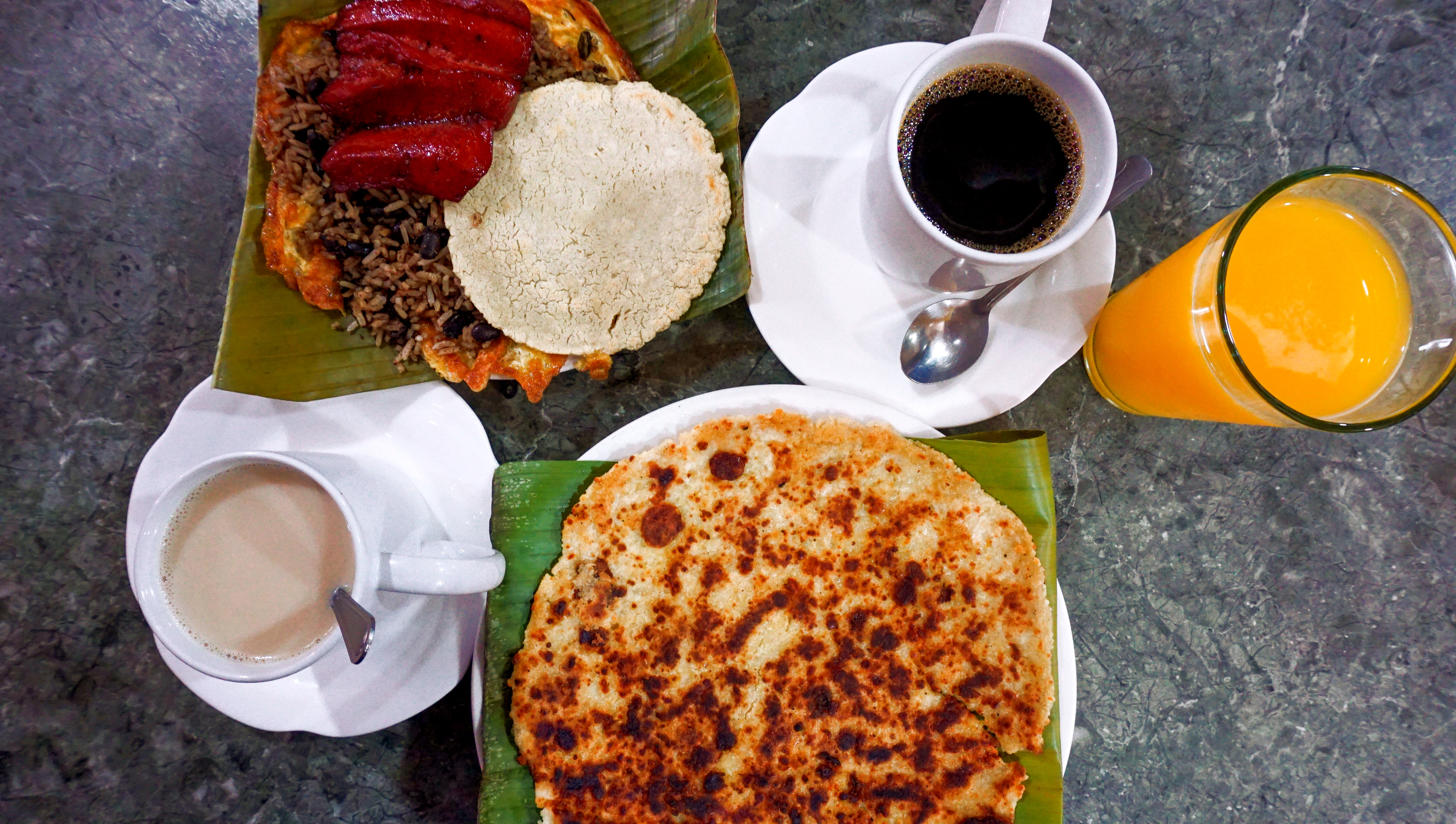 A full breakfast spread including coffee, juice, and Talapinto.