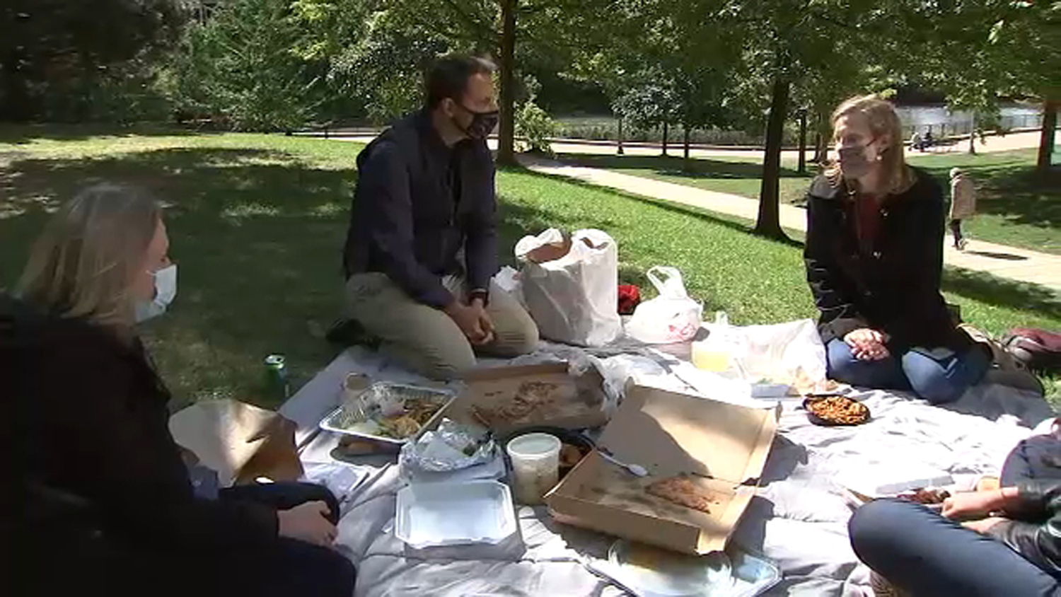 Sun-Times reporter Stephanie Zimmermann (from left), ABC7 reporter Jason Knowles and Jennifer Dunn of the Northwestern-Argonne Institute of Science and Engineering having a takeout picnic to look at the amount of plastic waste even one takeout or delivery meal creates.