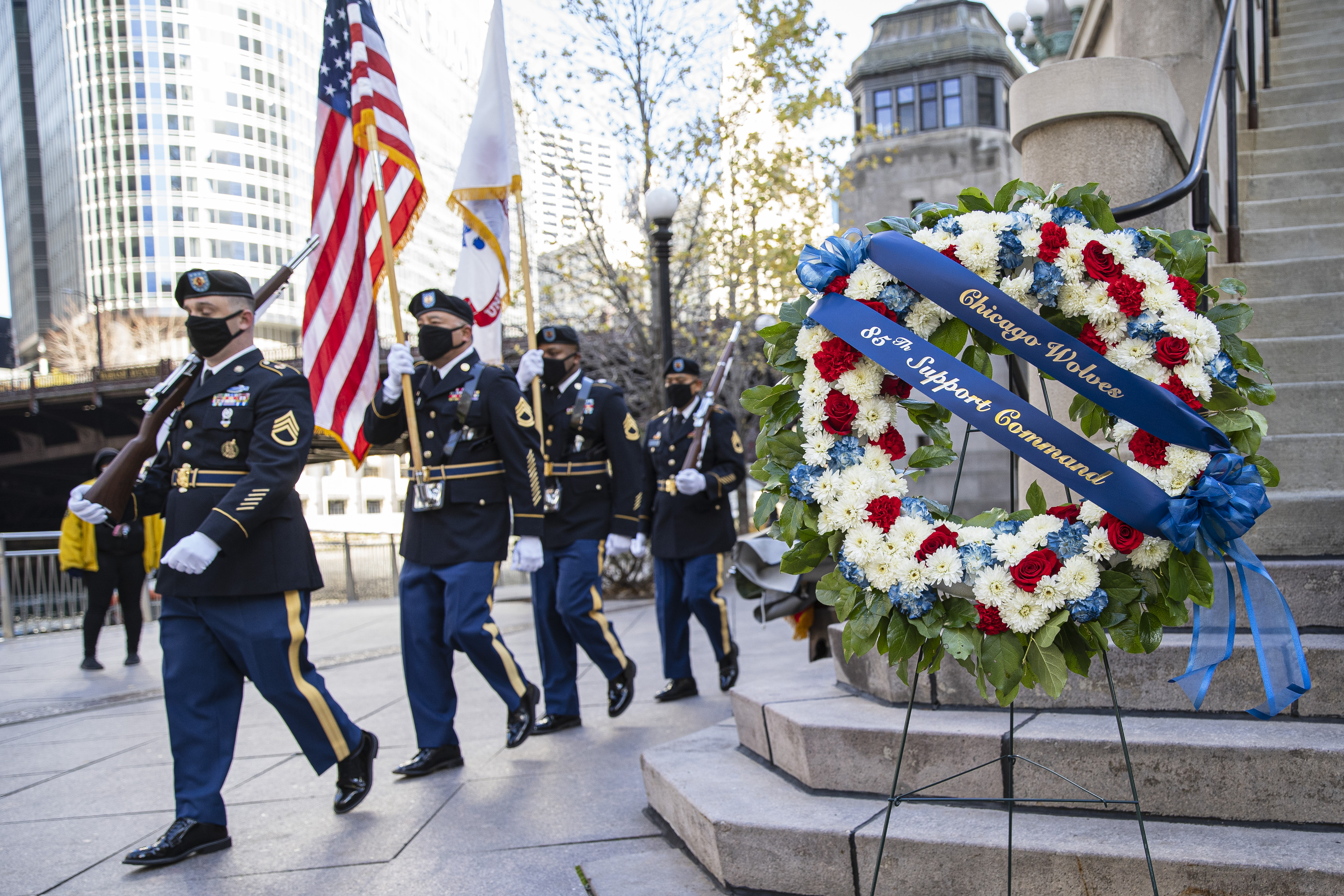 Army Color Guard present colors during a ceremony by The Wolves and the Arlington Heights-based 85th Support Command to honor veterans at the Vietnam Veterans Memorial on the Chicago Riverwalk.