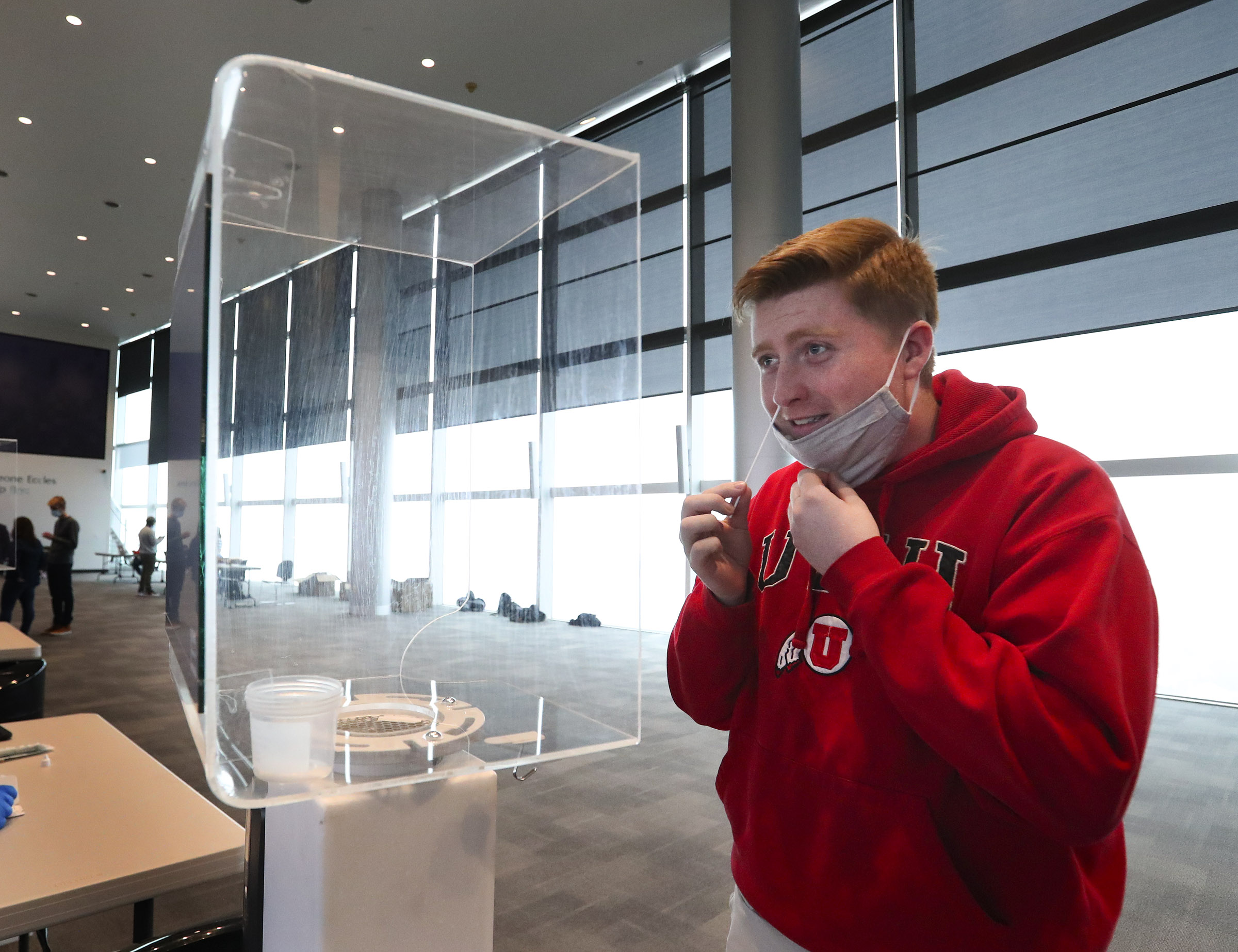 University of Utah sophomore Jared Peters swabs his nostril for a rapid COVID-19 test at Rice-Eccles Stadium in Salt Lake City on Wednesday, Nov. 11, 2020. The university has launched an initiative to test 32,000 students for COVID-19 before the Thanksgiving break.