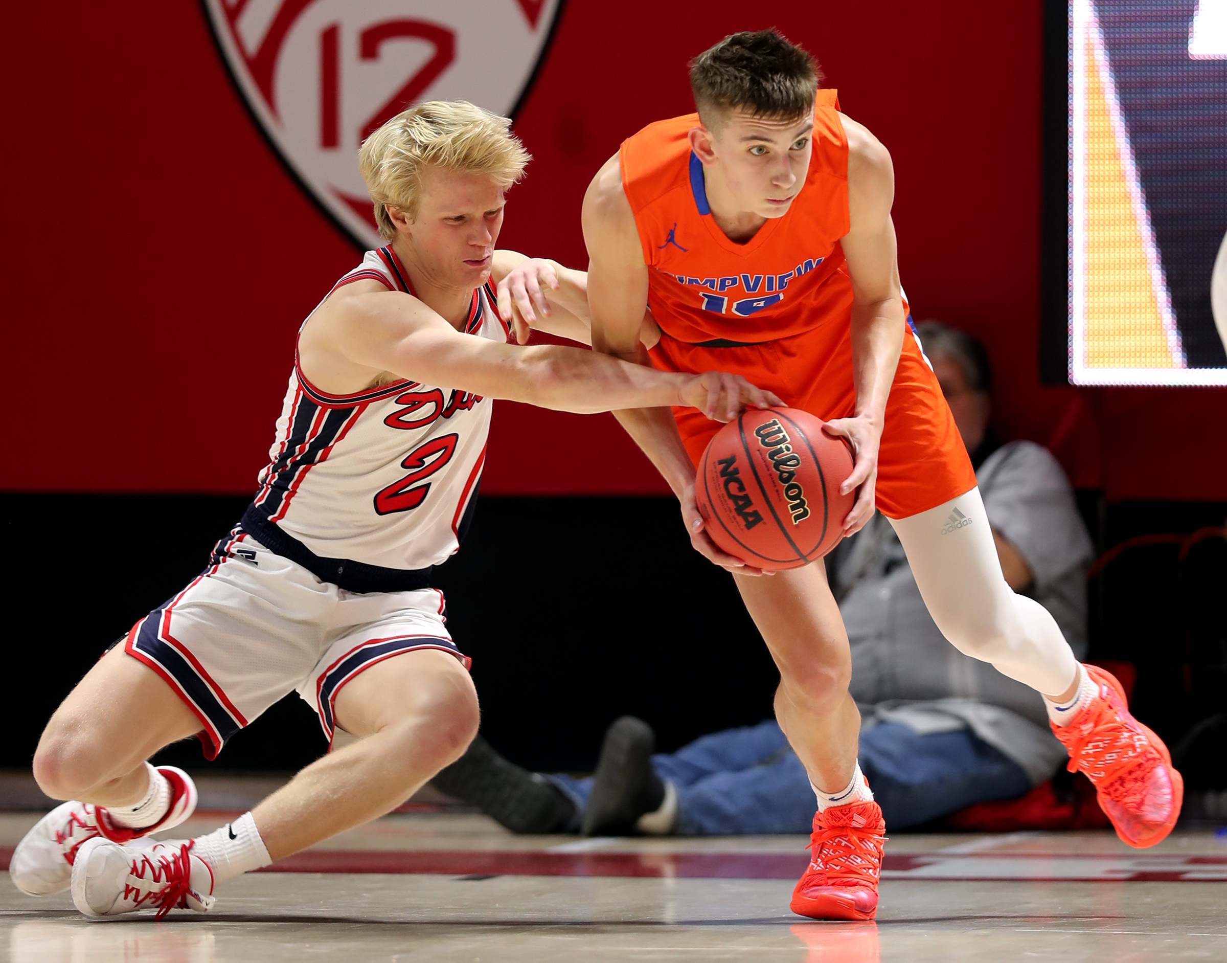 Springville's Austin Mortensen tries to knock the ball away from Timpview's Jake Wahlin as the two teams play in the 5A boys state basketball championship in the Huntsman Center in Salt Lake City on Saturday, Feb. 29, 2020. Springville won 66-53.