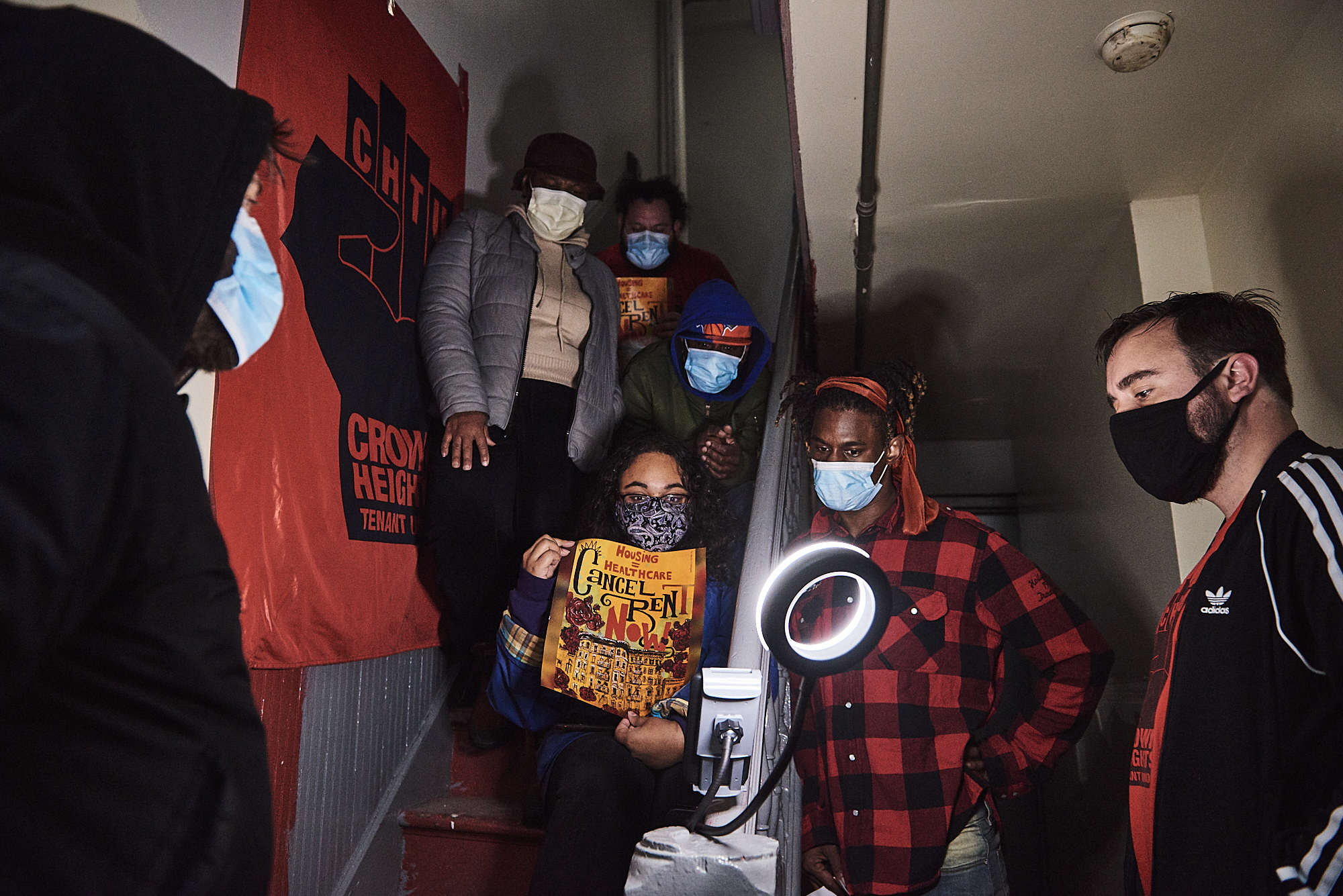 """Dexter Lendor and Delene Ahye attend """"stoop court"""" with neighbors and activists from the Crown Heights Tenants Union in the basement of their Prospect Lefferts Gardens apartment on Oct. 30, 2020."""