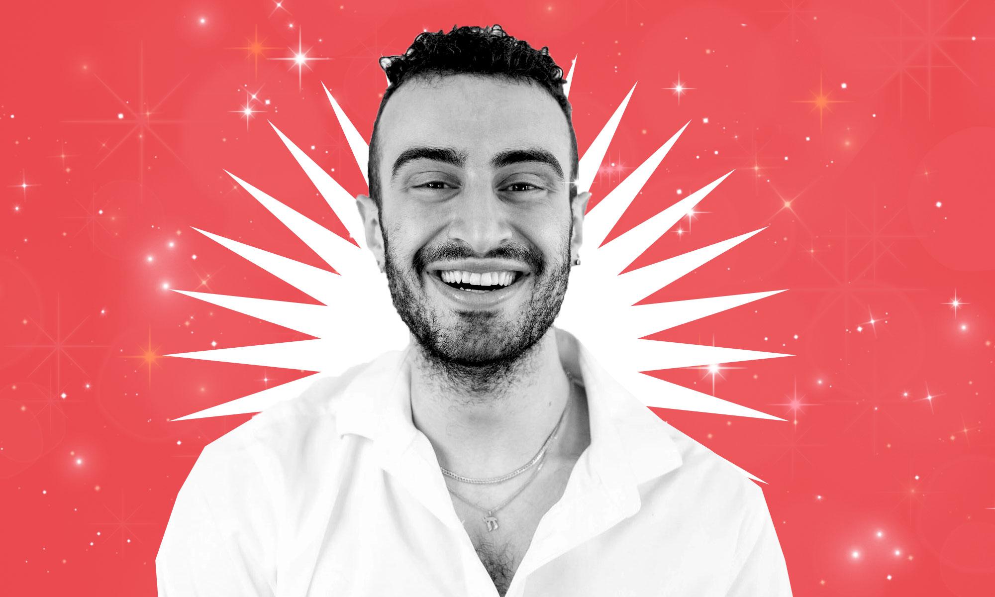 Smiling man with beard wearing white collared shirt.