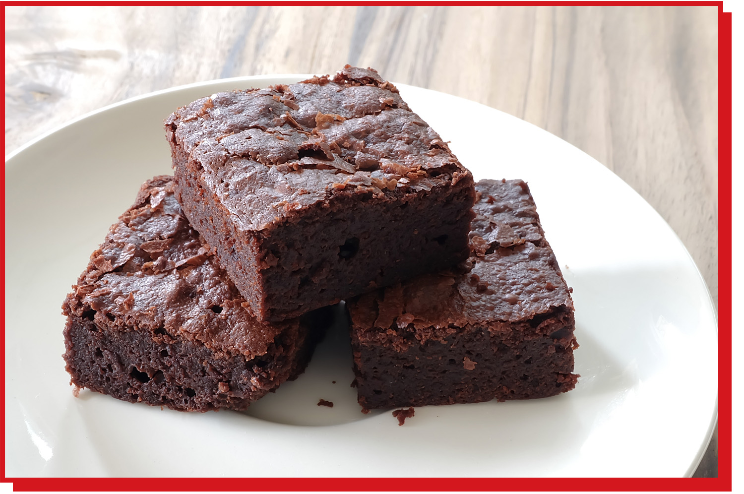 Three brownies on a plate.