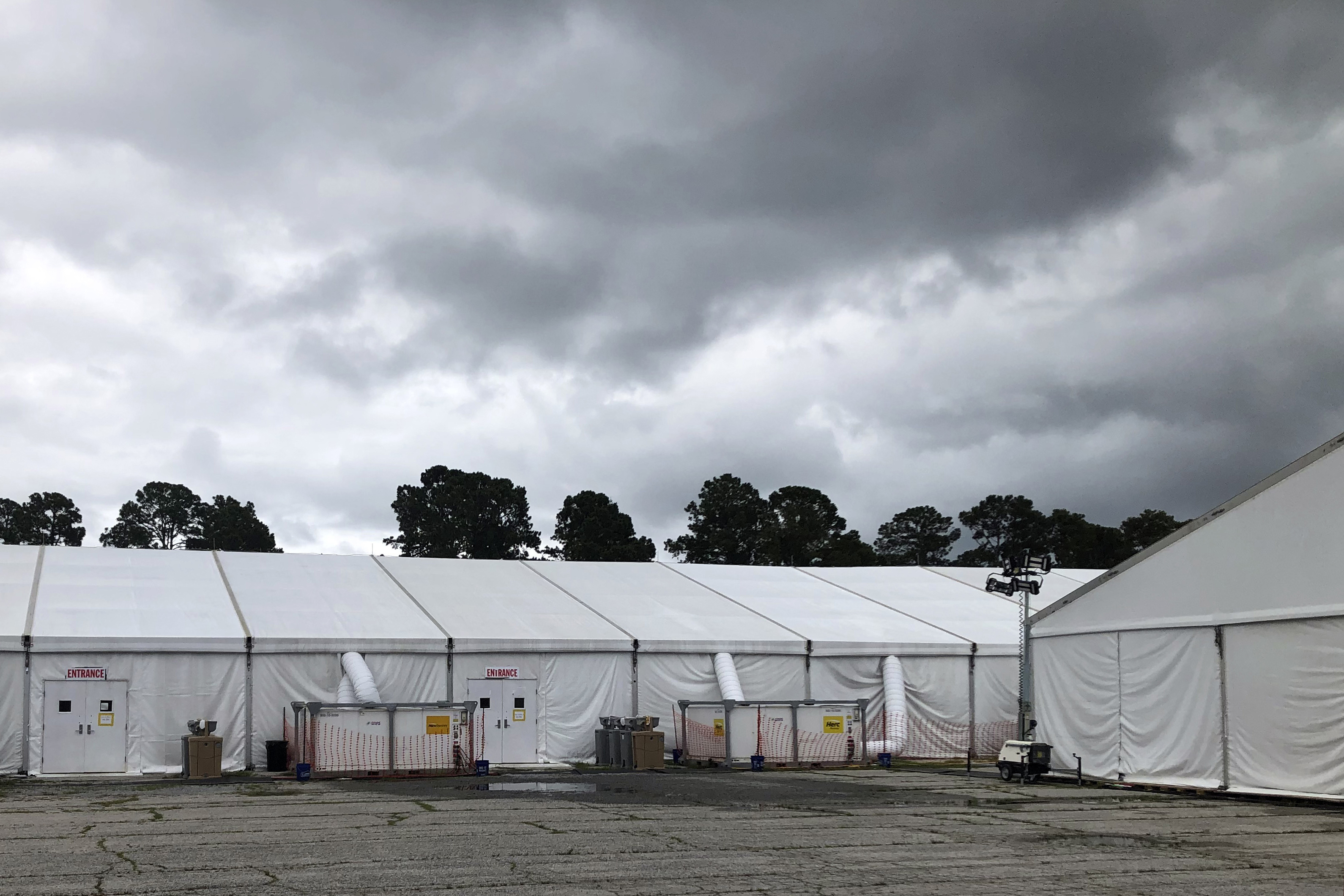 In this May 27, 2020 file photo, quarantine tents set up for recruits arriving at the Marine Corps' Parris Island Recruit Depot, S.C. The tents were used until earlier in the week and now recruits go through quarantine at the Citadel, the Marine college in Charleston, S.C.