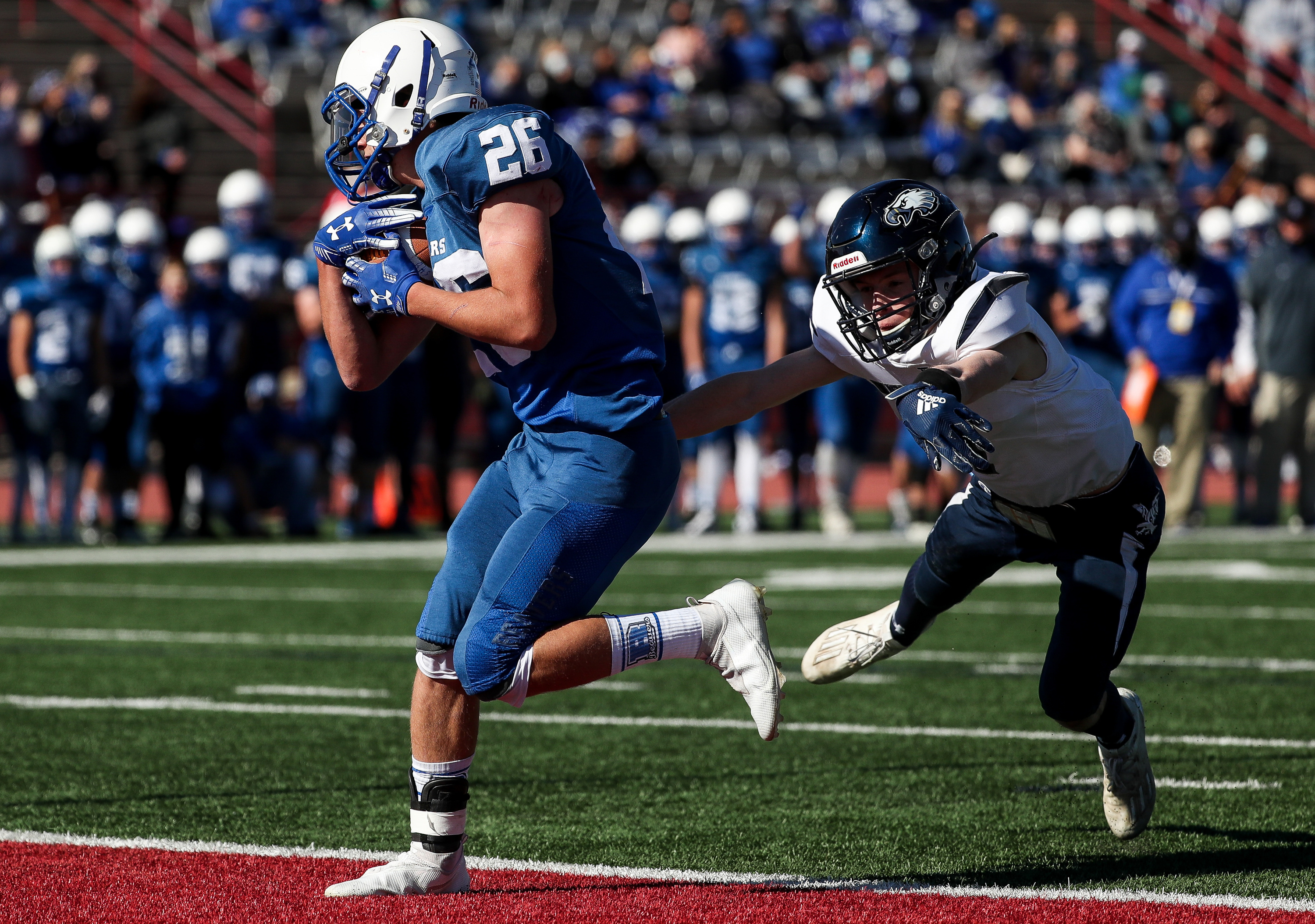 Beaver's EJ Allred runs a reception into the end zone ahead of Duchesne's Parker Crum, putting Beaver up 7-0 after the point after touchdown, in the 2A football championship game at Dixie State University in St. George on Saturday, Nov. 14, 2020.