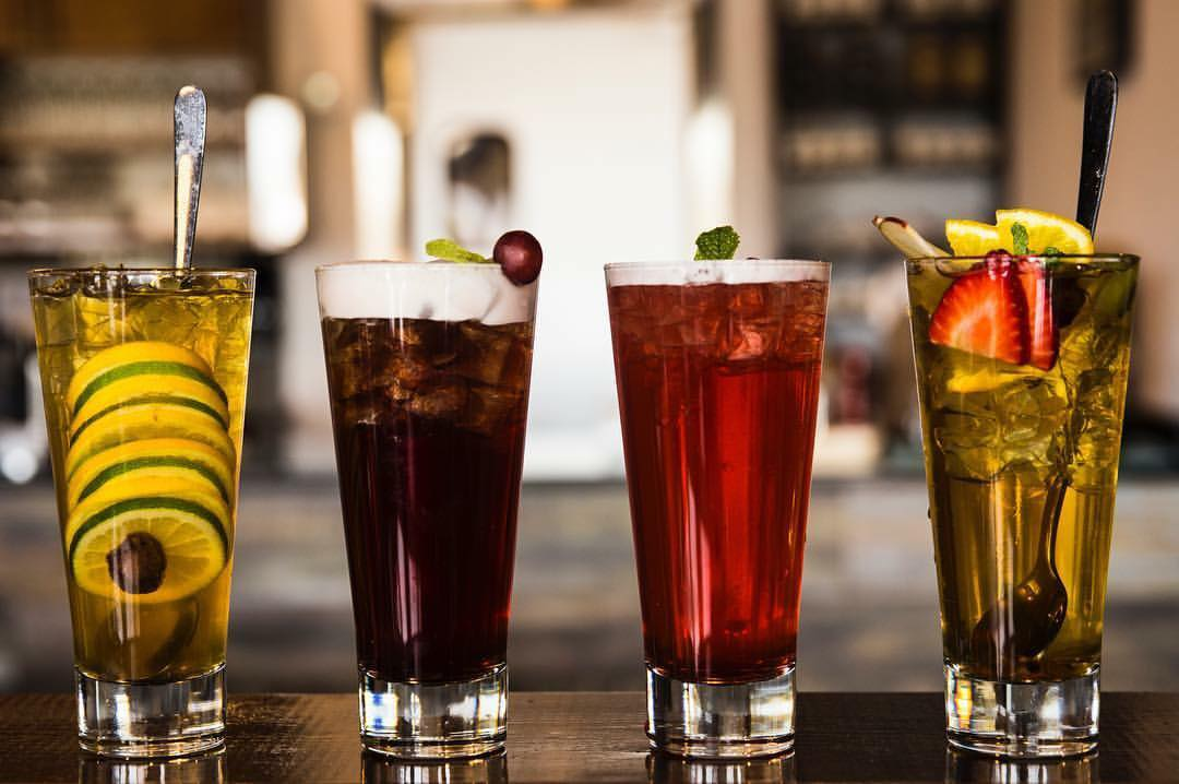 Four large glasses containing a variety of cold tea drinks from Tea House Formosa in on Buford Highway in Doraville, Georgia