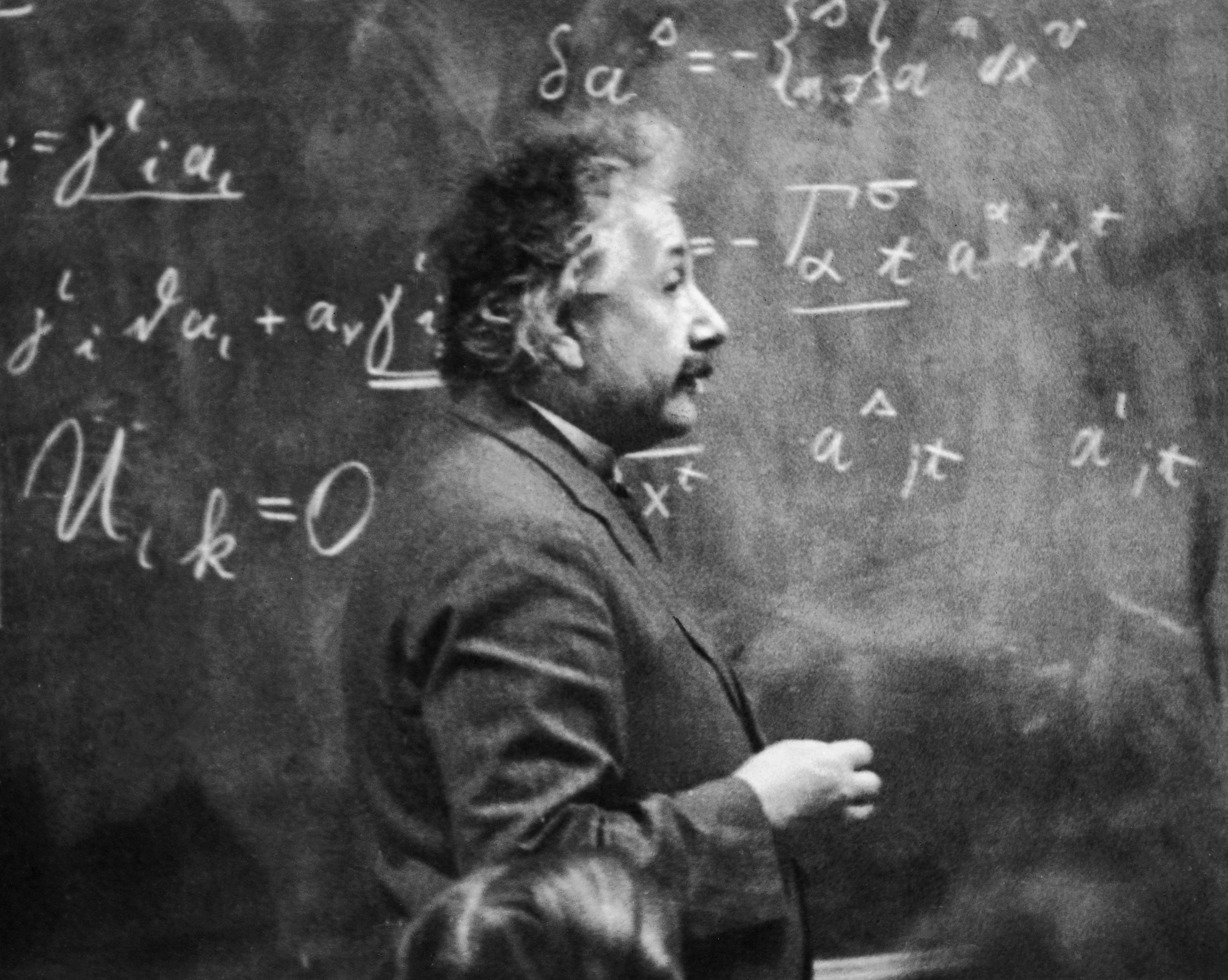 Einstein at blackboard with his equations