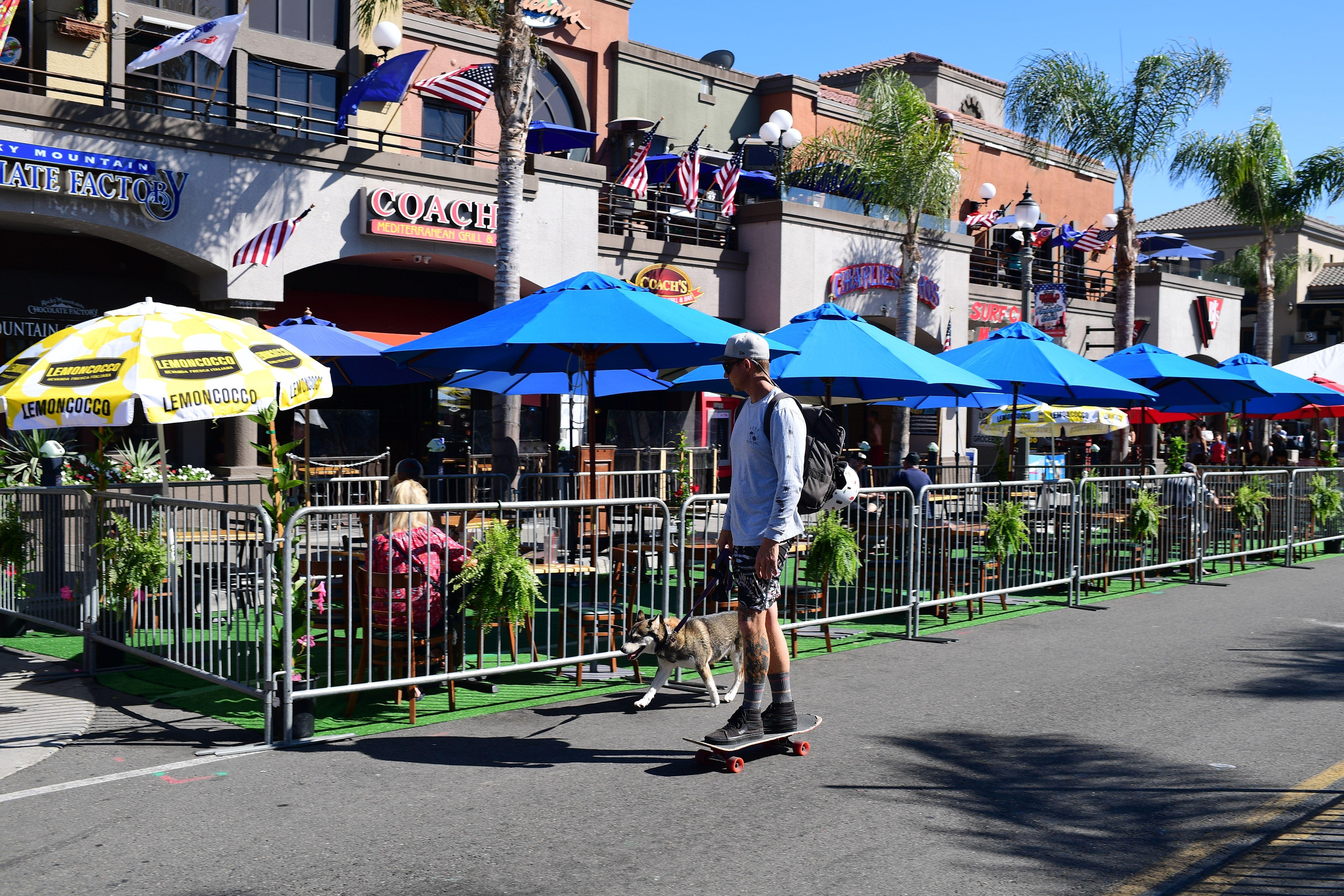 Restaurants set up outside tables in Huntington Beach, California.