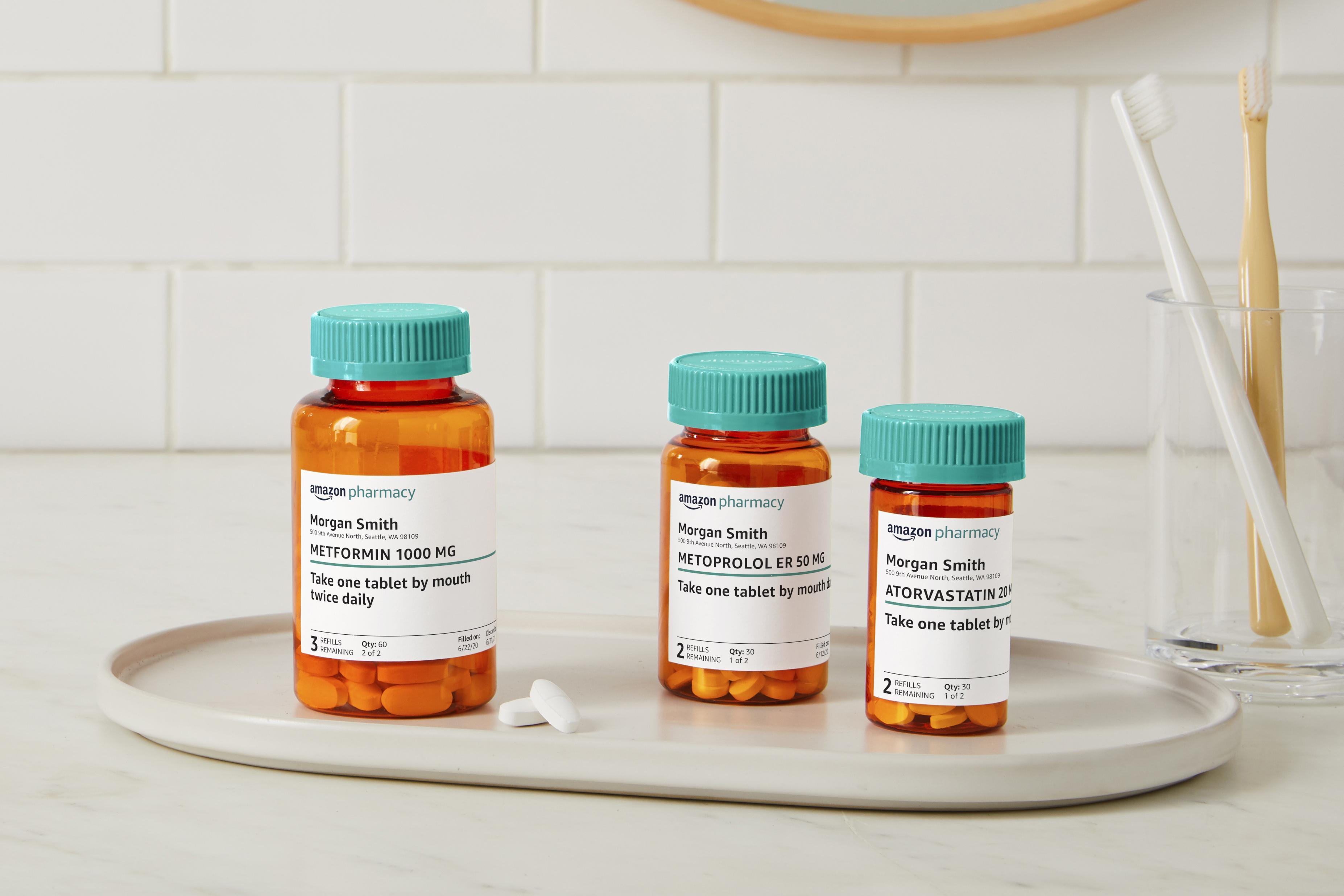 Three prescription pill bottles on a tray.