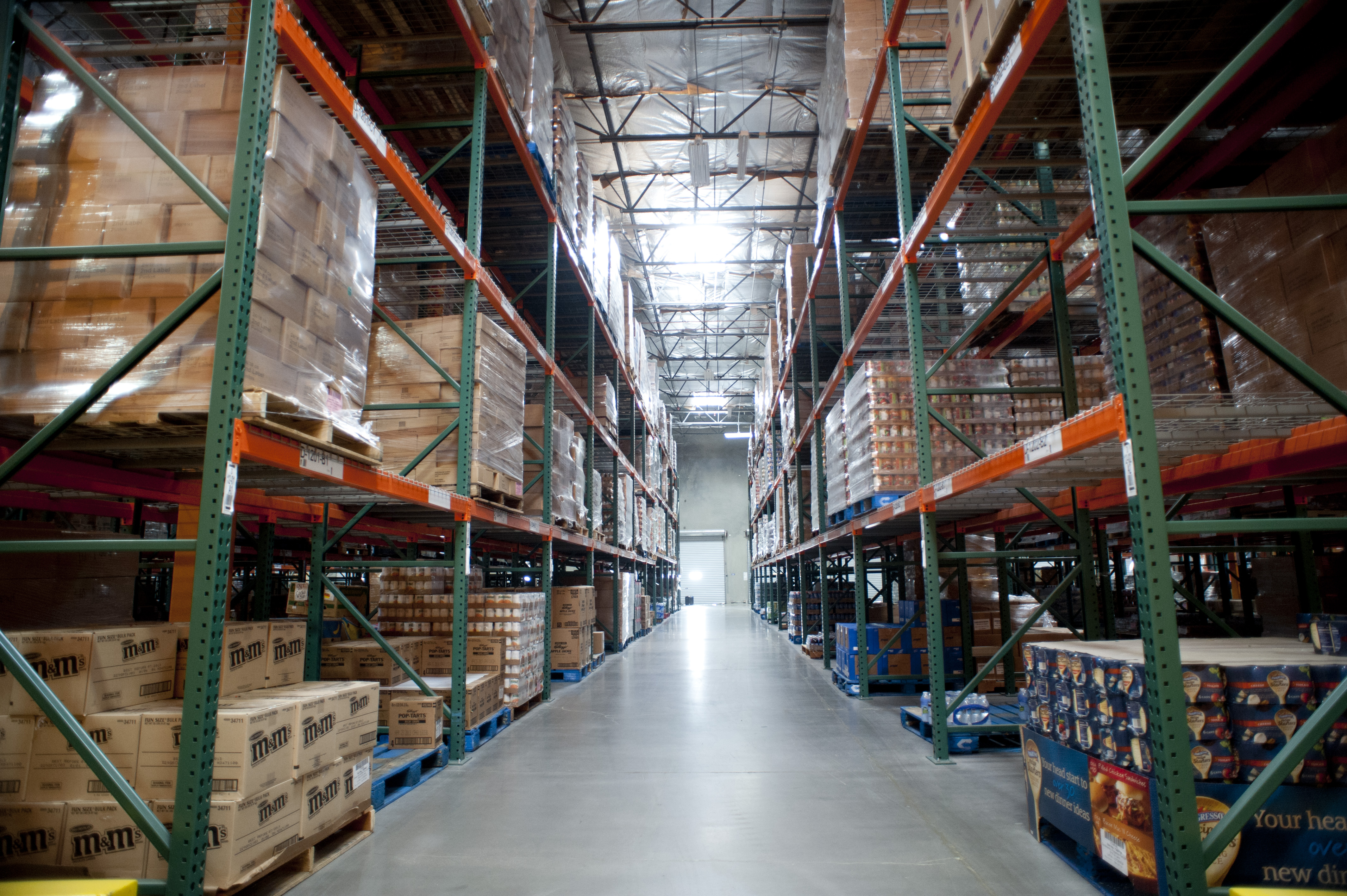 A warehouse aisle filled with boxes of food