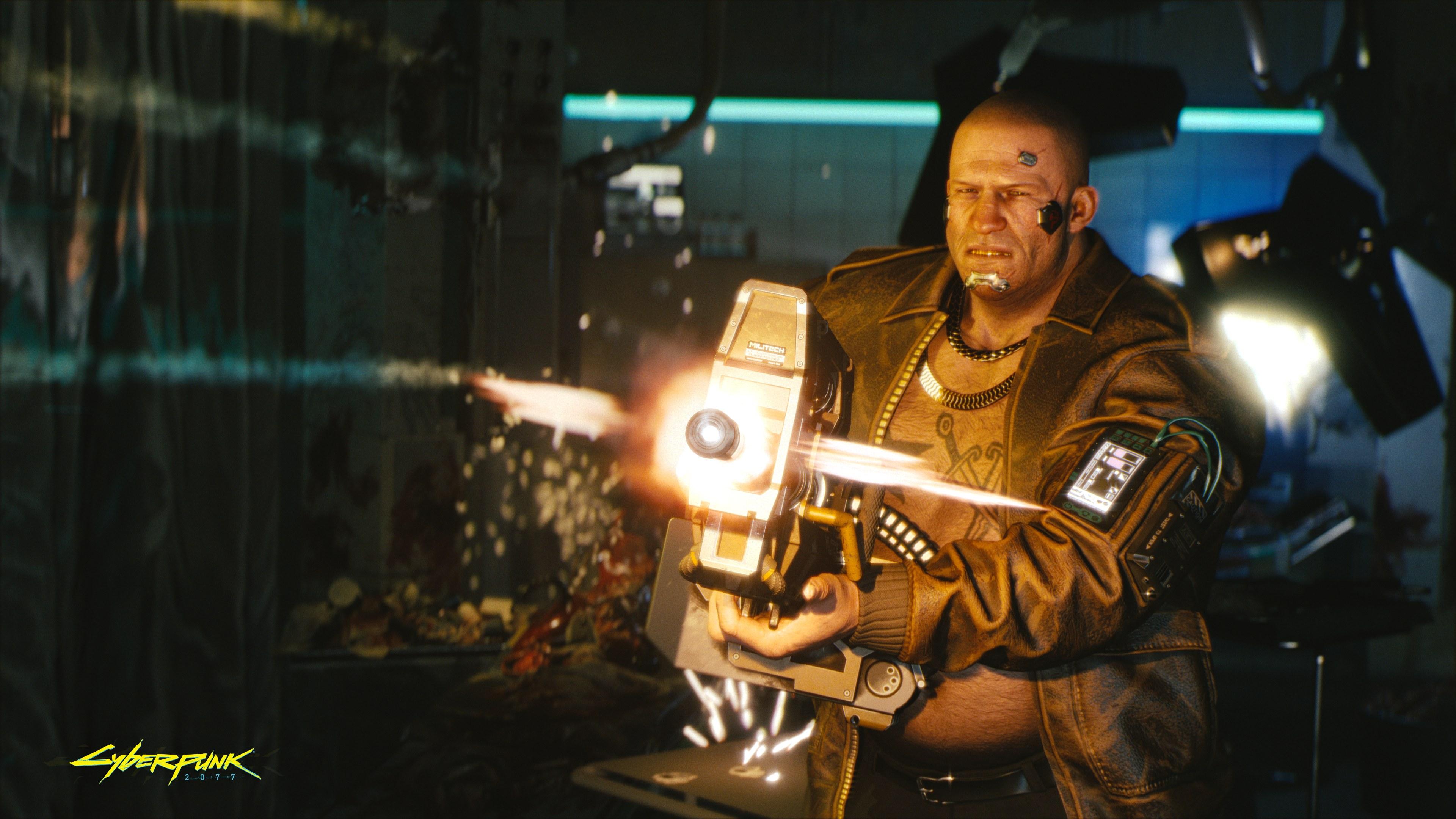 A big man with a big gun, lit by muzzle flash.