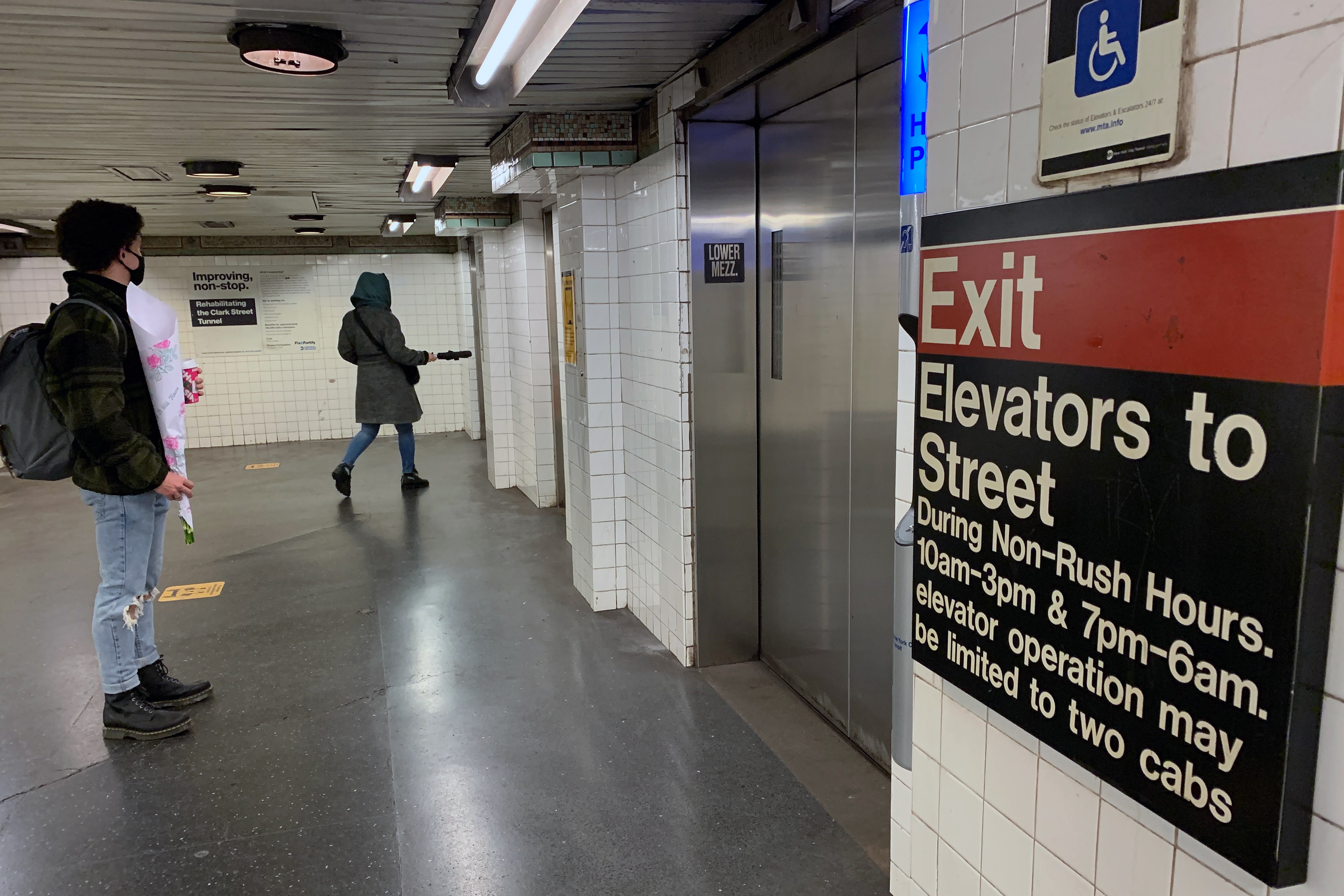 Riders wait for elevators at the Clark Street station in Brooklyn Heights, Nov. 17, 2020.