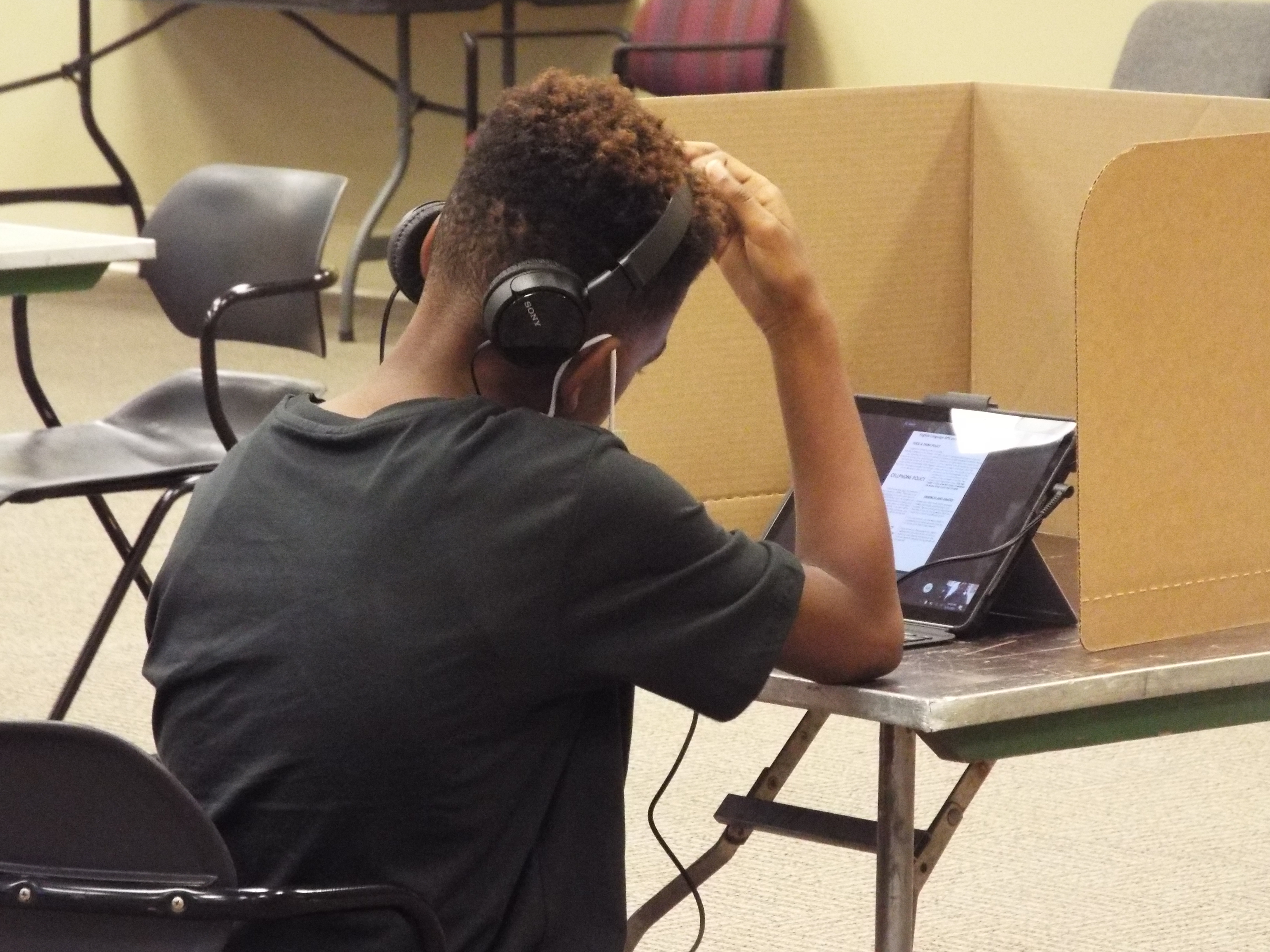 Shelby County Schools students works remotely from the YMCA's virtual learning center on the first day of school.