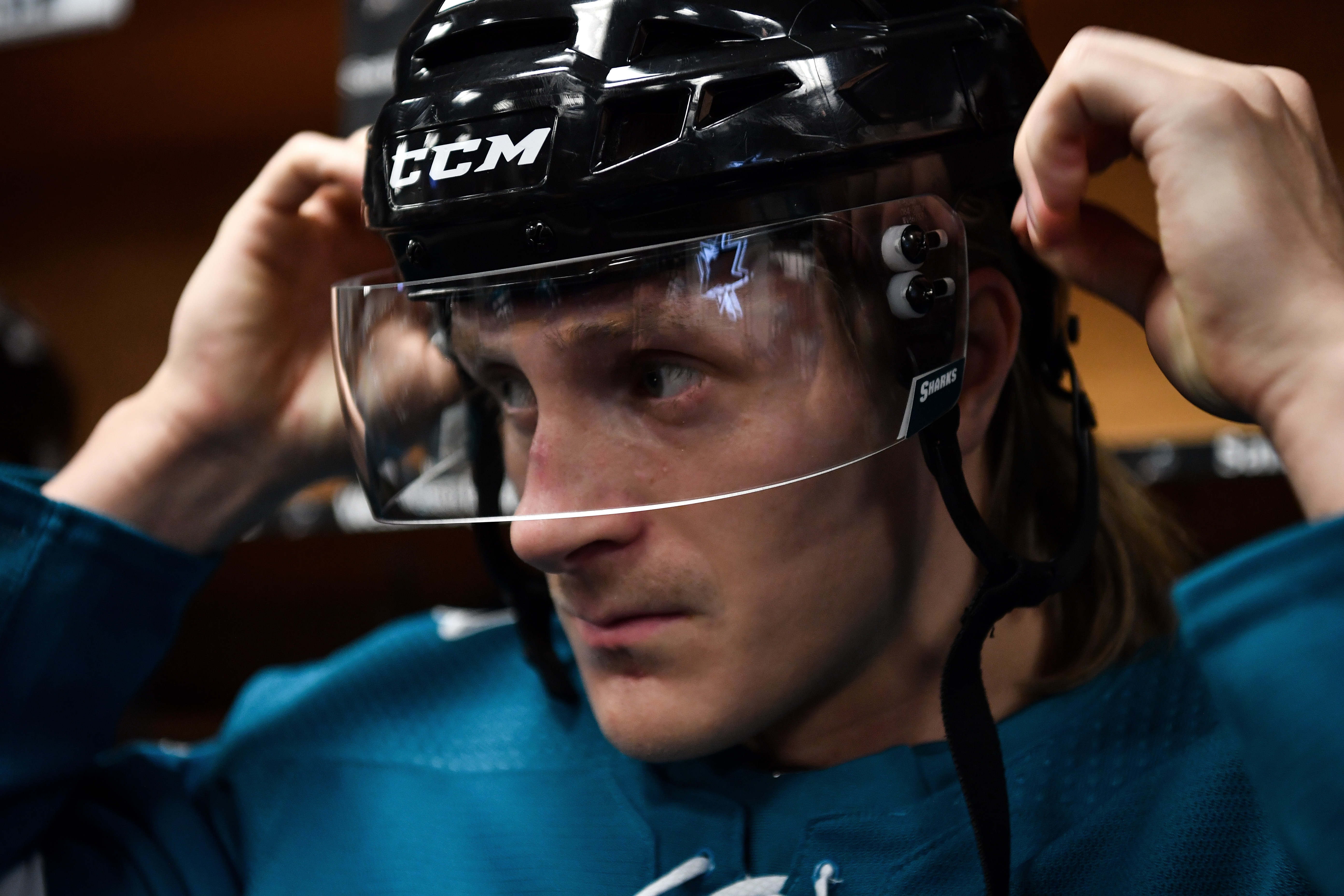 Marcus Sorensen #20 of the San Jose Sharks prepares to take the ice for warmups in the locker room against the Ottawa Senators at SAP Center on March 7, 2020 in San Jose, California.