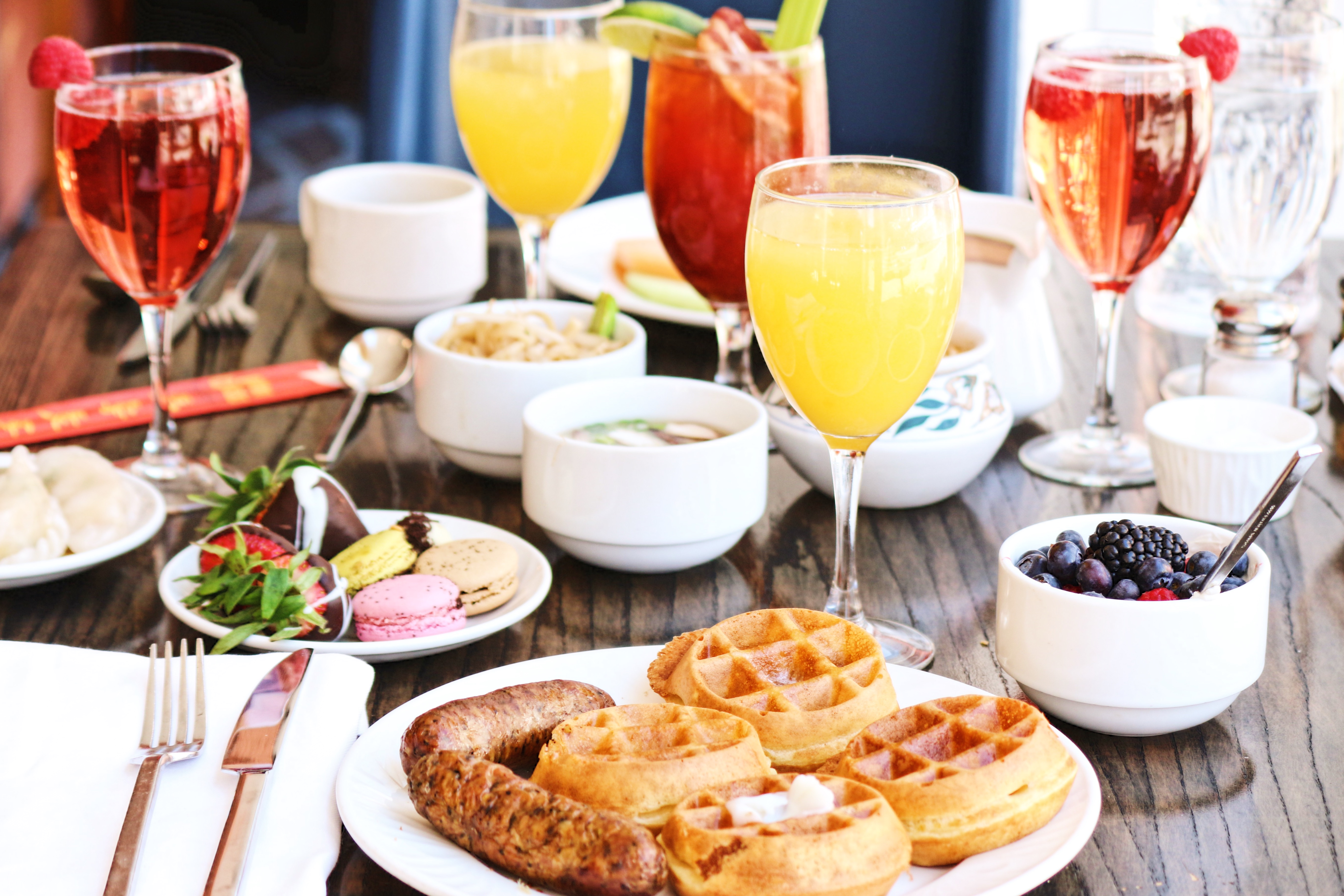 A brunch set-up with waffles and mimosas.