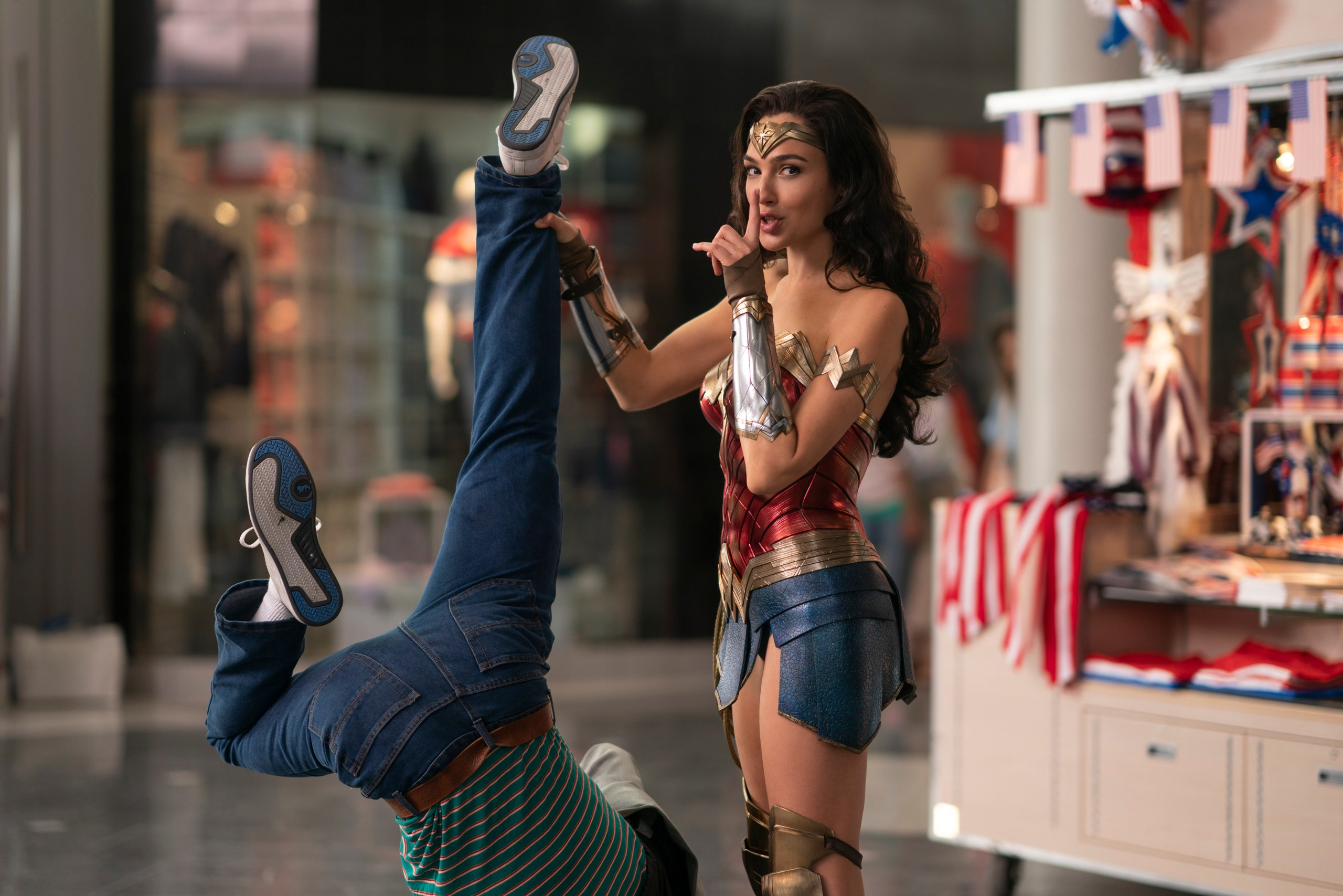 Wonder Woman holding up someone by the leg in Wonder Woman 1984.
