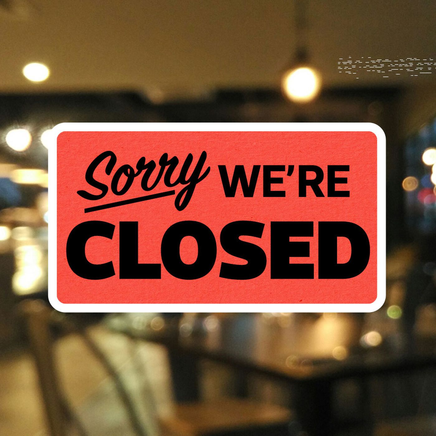 "A ""Sorry, We're Closed,"" sign in a nondescript window"