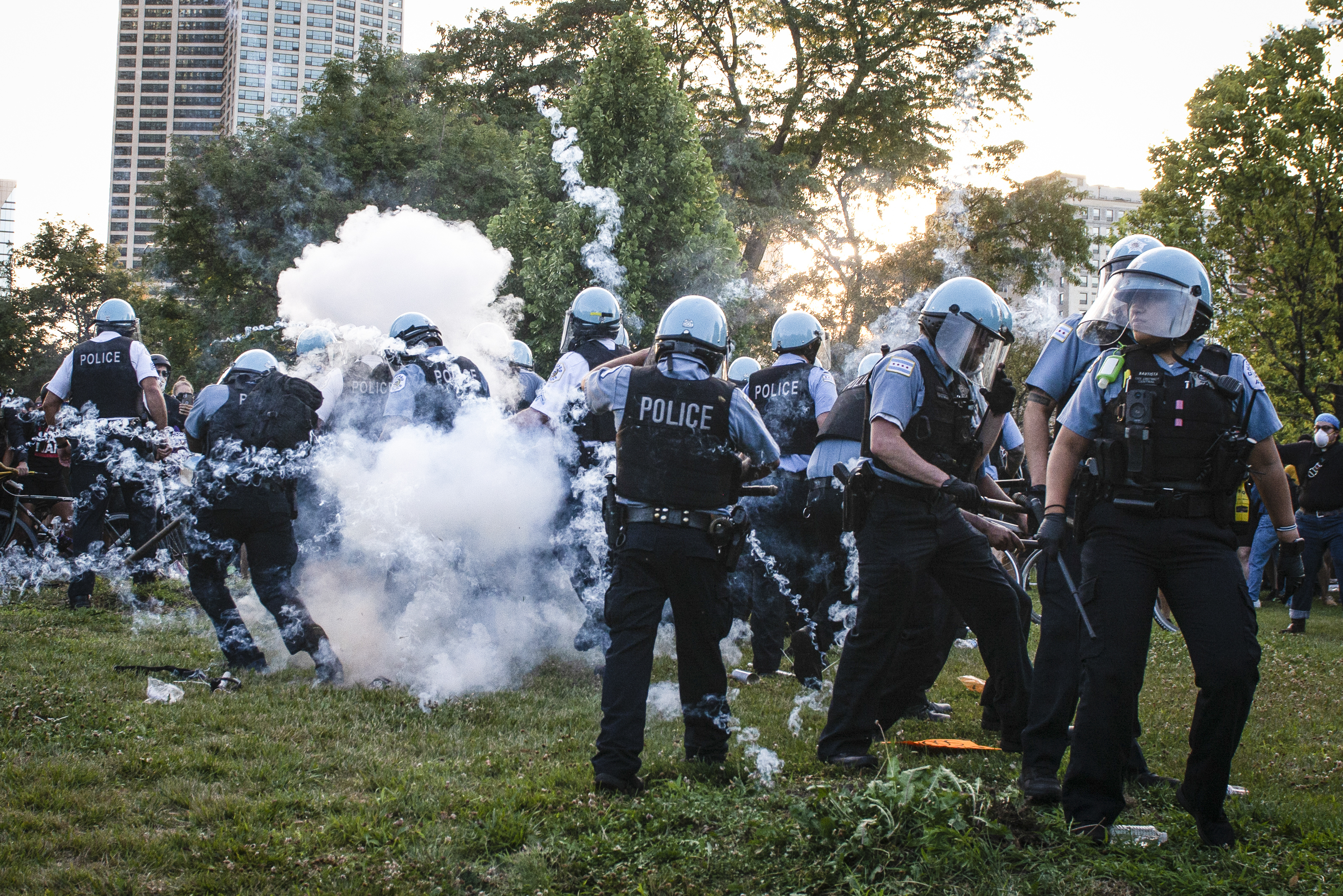 Hundreds of protesters surrounded the Christopher Columbus statue in Grant Park on Friday. They attempted to pull the statue down and many battled with Chicago Police.